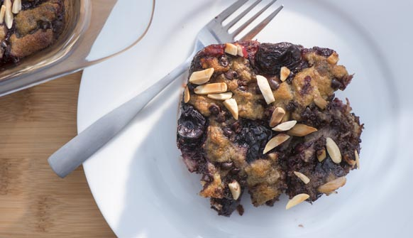 Dark Chocolate Fruity Bread Pudding on plate with fork