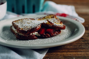 French Toast Berry Sandwich with powdered sugar