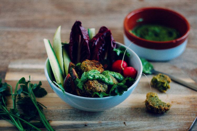 Breaded falafel in bowl with vegetables