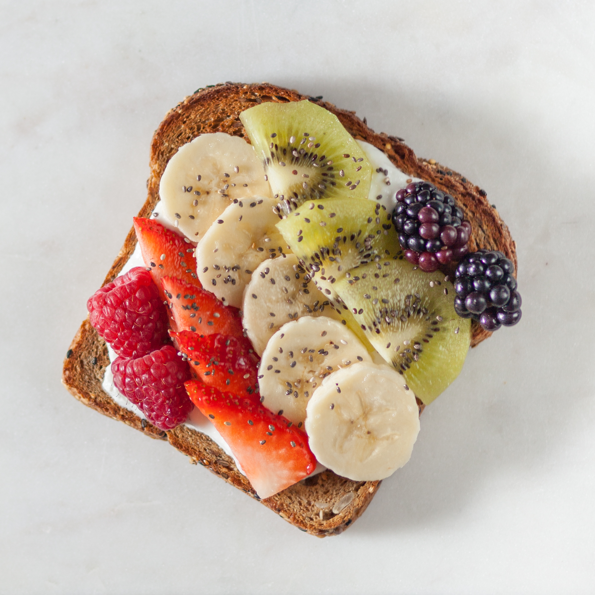 Toast with greek yogurt and miscellaneous fruit