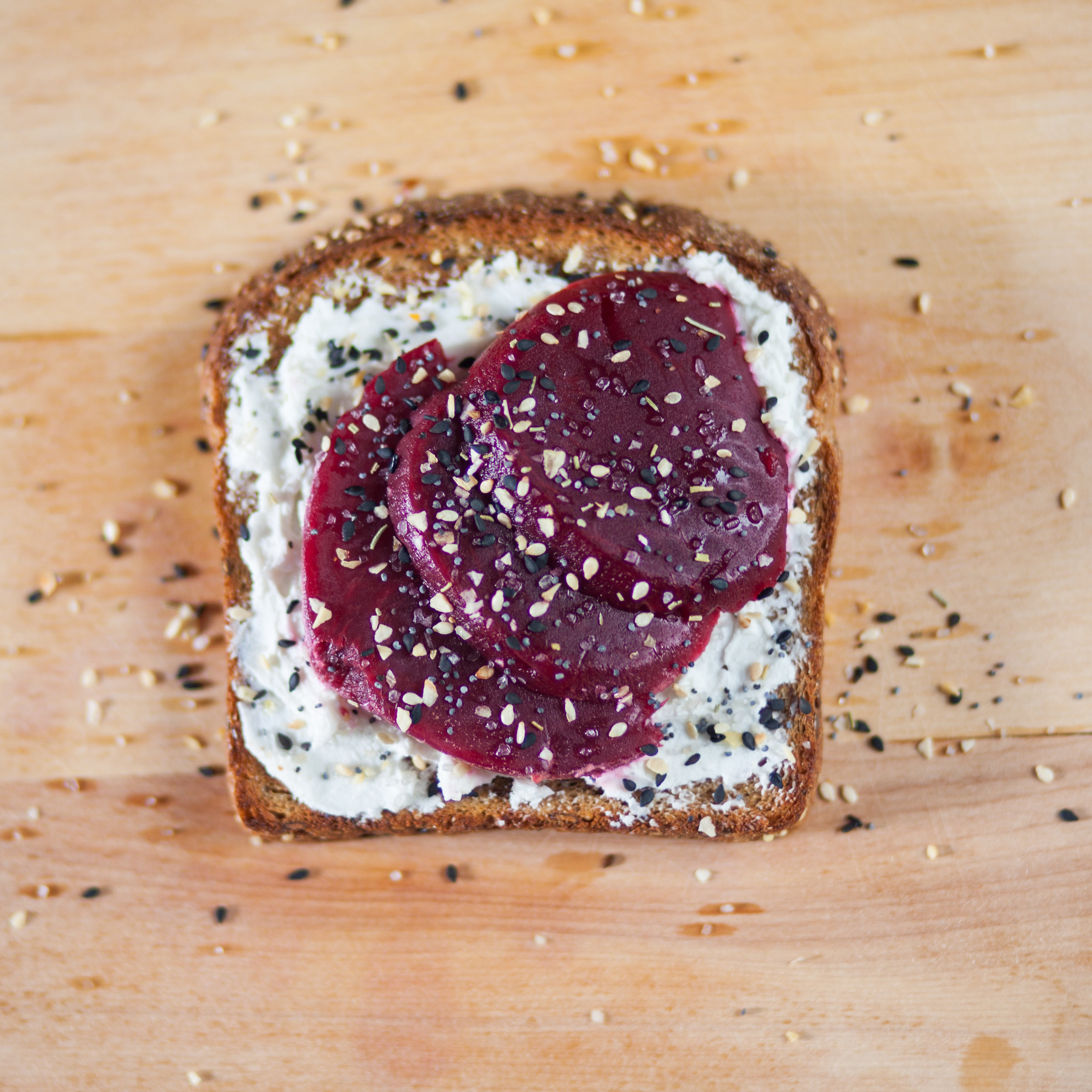 Toast with goat cheese and jellied cranberry sauce