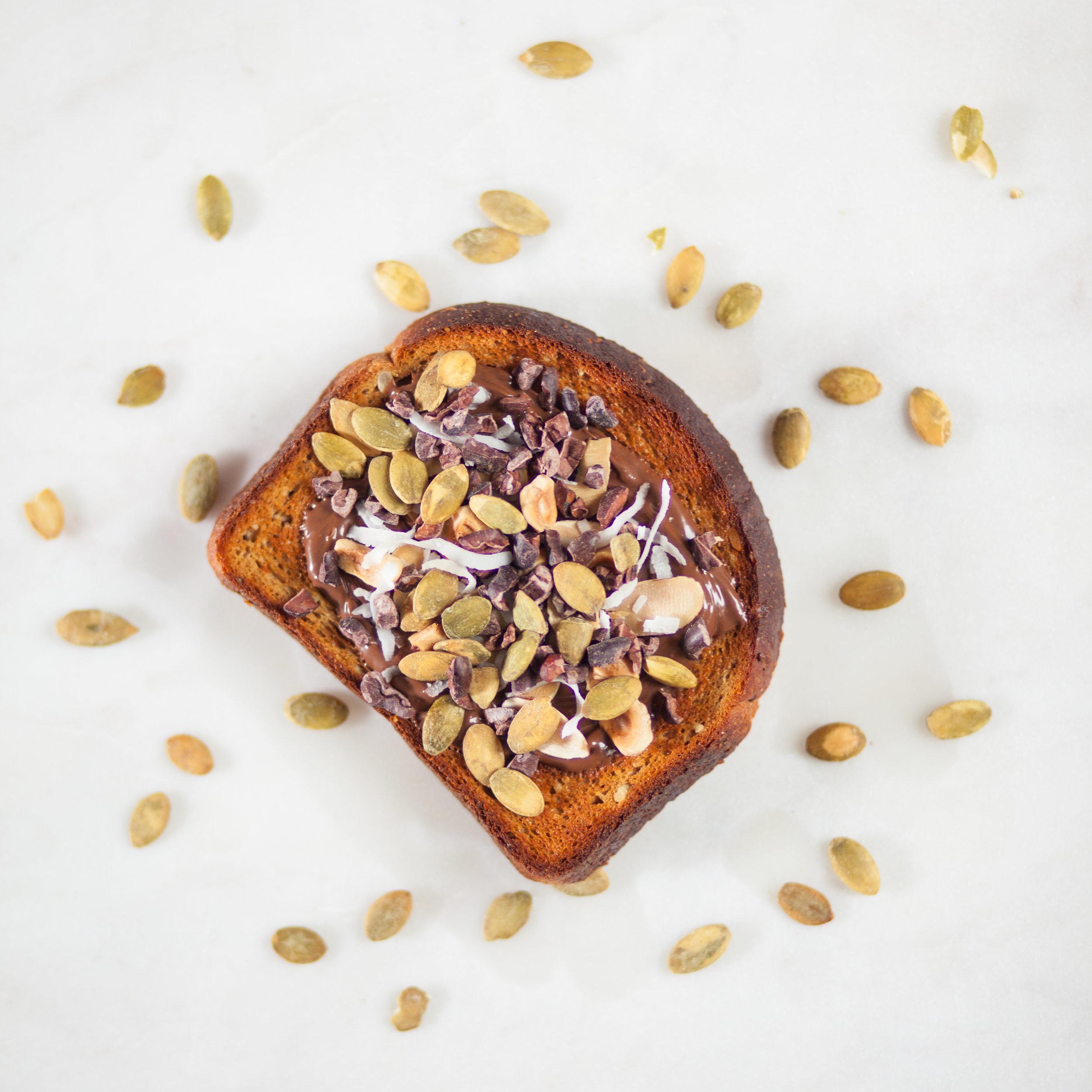 Toast with hazelnut spread, pumpkin seeds and coconut
