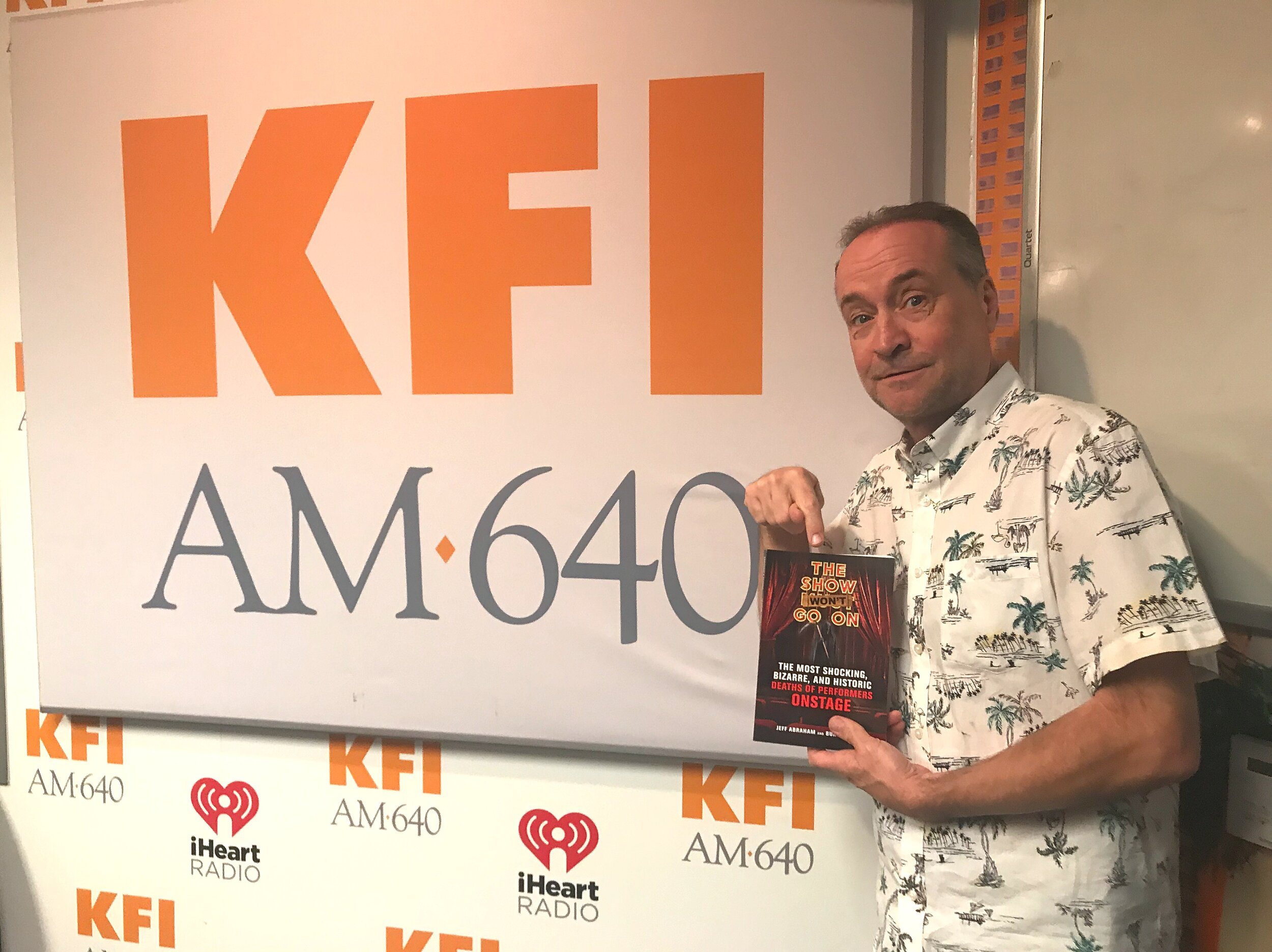 RADIO STAR TIM CONWAY JR., HOST OF  THE TIM CONWAY JR. SHOW  ON KFI-AM IN LOS ANGELES & iHEART RADIO, SHOWS OFF HIS COPY OF  THE SHOW WON'T GO ON  AFTER HIS INTERVIEW WITH THE BOOK'S AUTHORS.