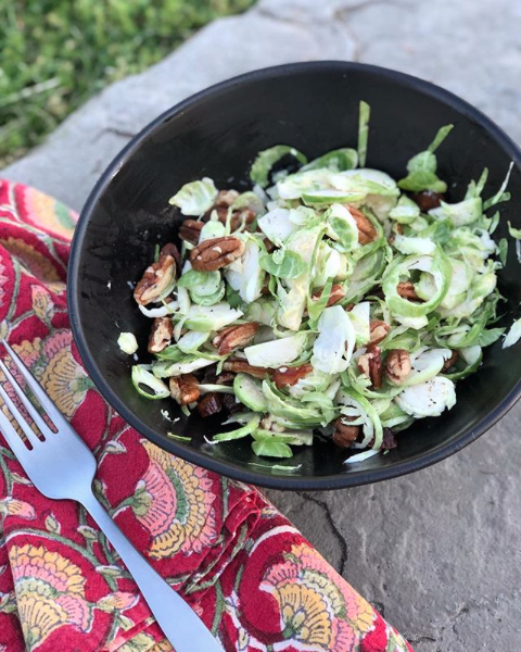 Raw Brussel Sprout Slaw Salad with Pecans Dates Lemon and Mayonnaise Completely Golden .png