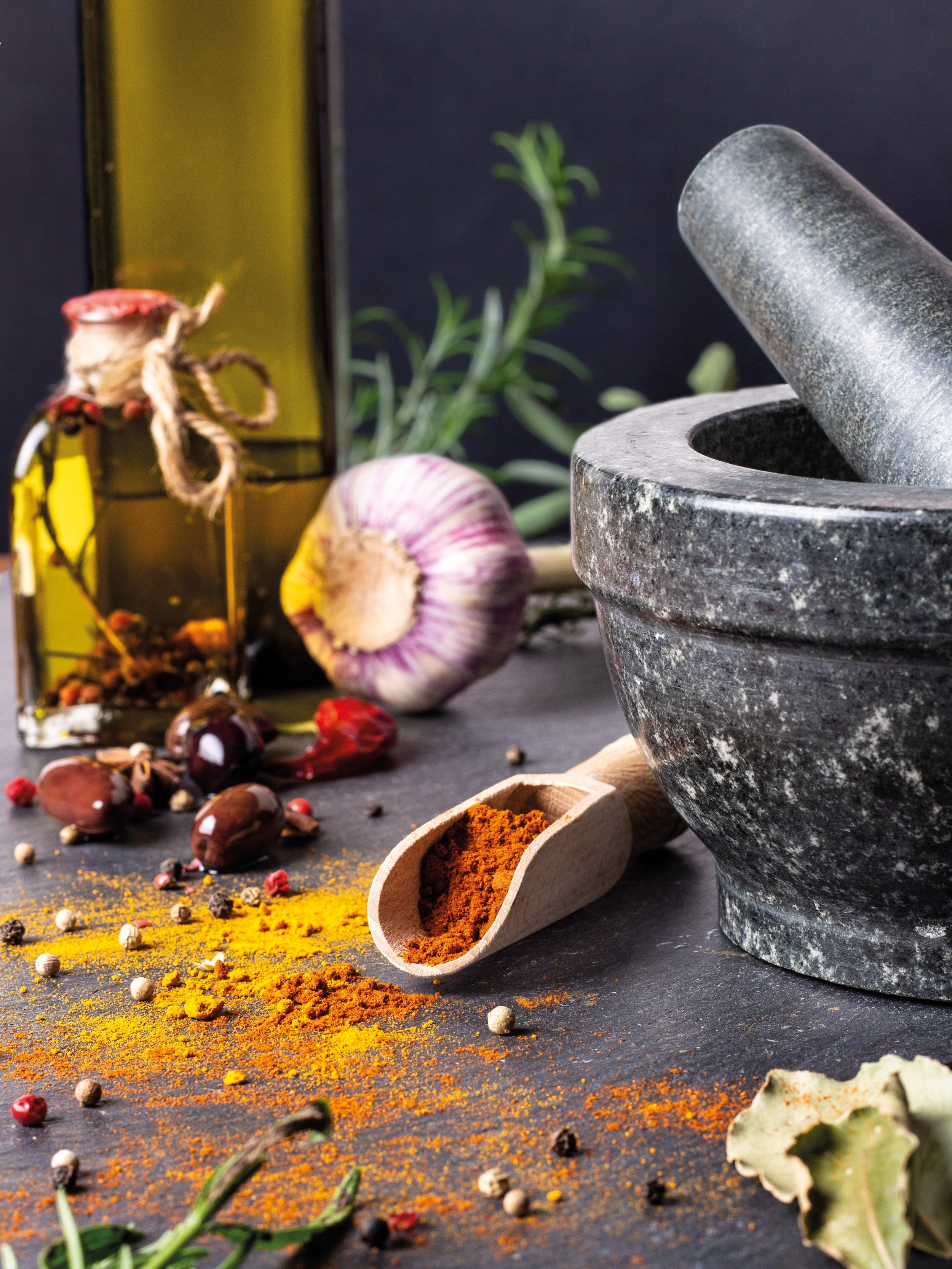 Everything you Need to Know for a Successful Pantry Reset Completely Golden Blog Garlic and Olive Oil with Spices and Mortor and Pestle.jpg