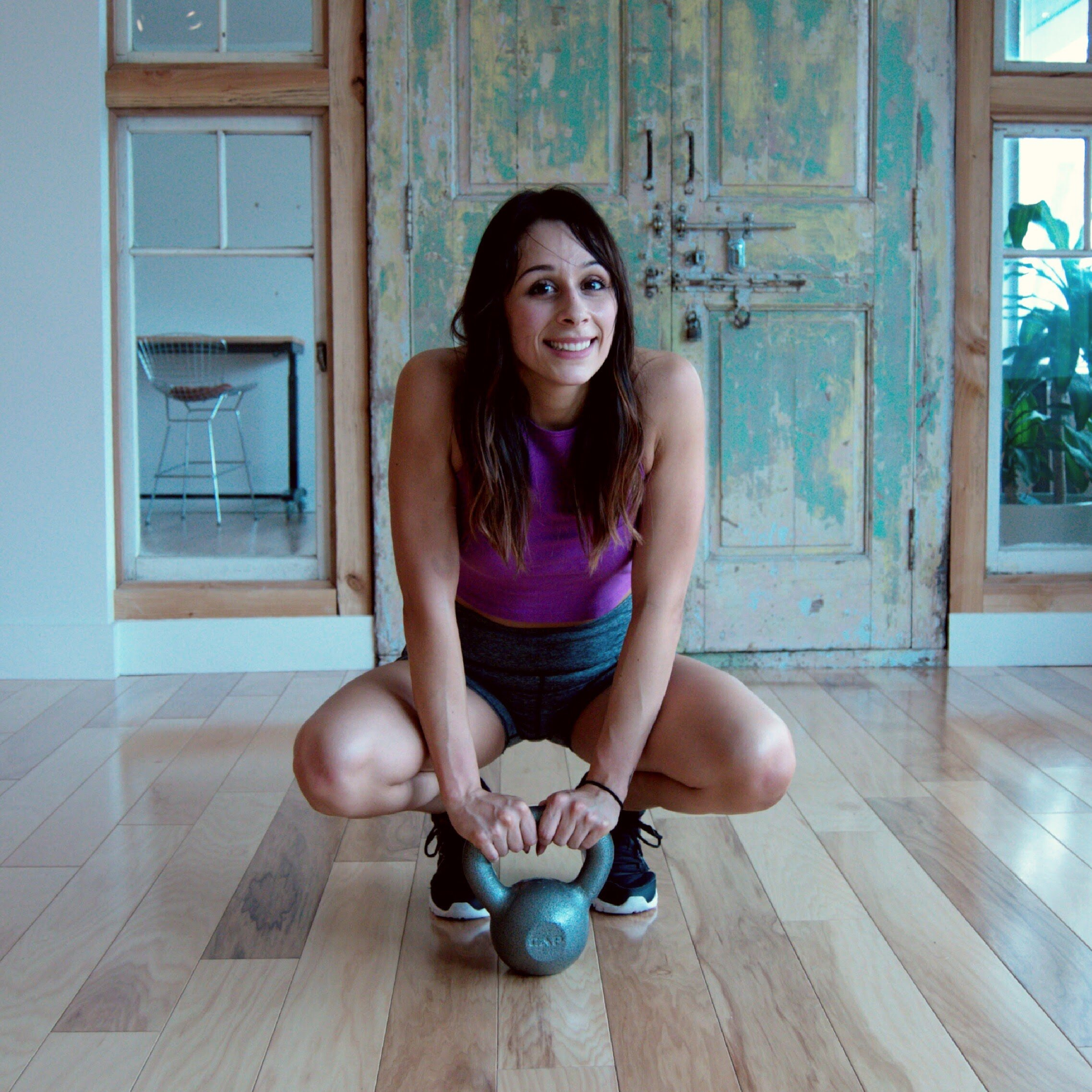 My very first photoshoot. I have since graduated to 35lb kettlebells!