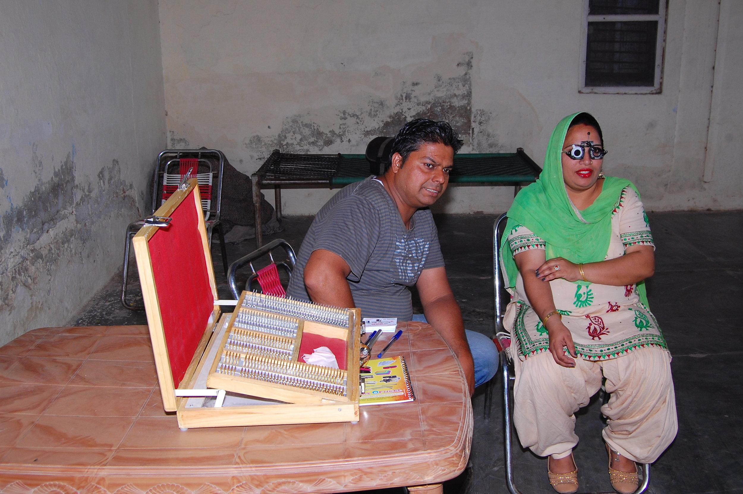 Optometrist checks artisan's vision