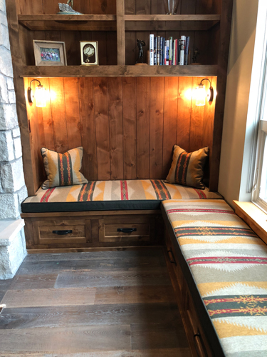 A cozy reading nook ready for a roaring fire and a good book!