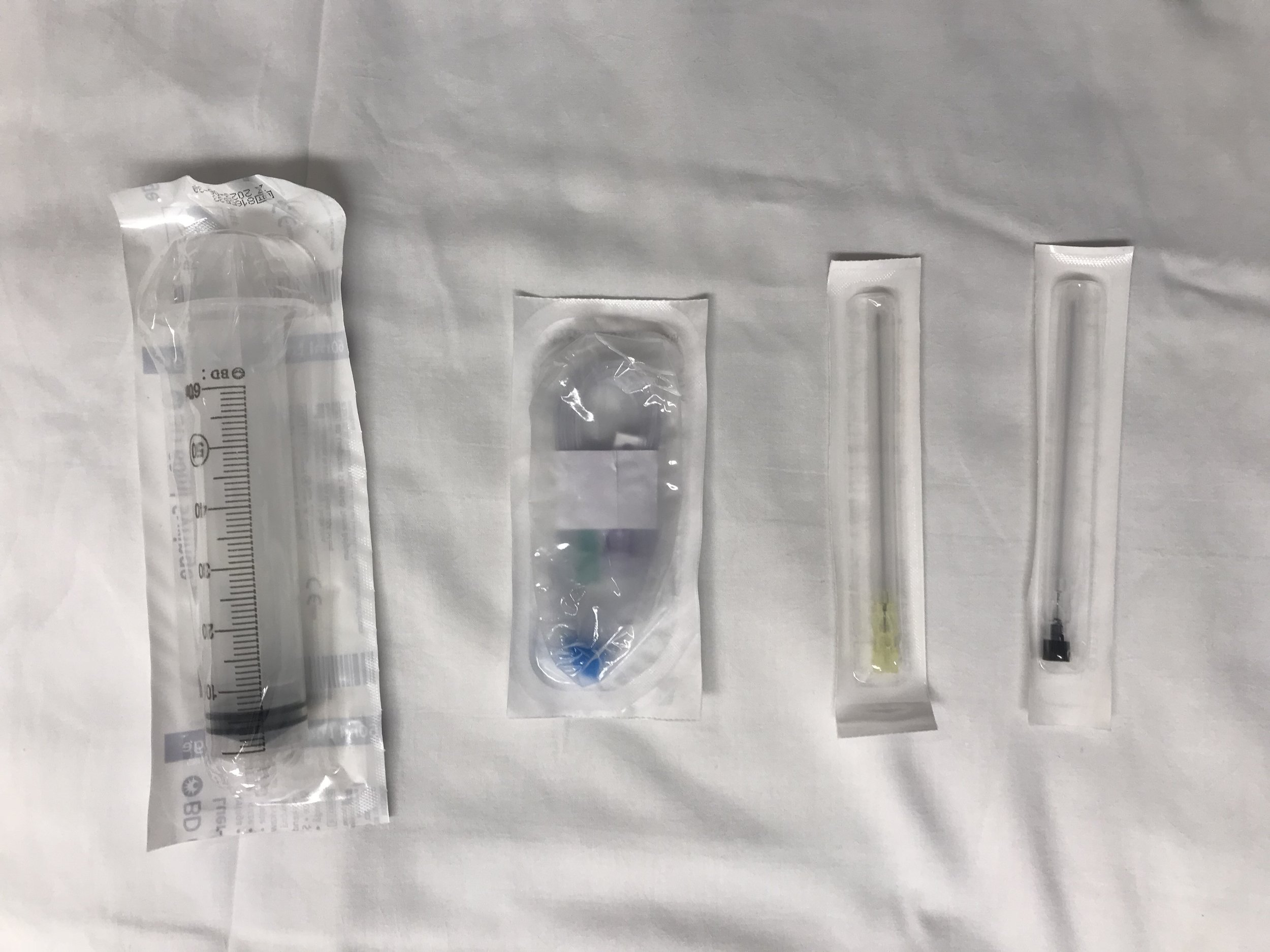 Obtain a 60cc syringe, extension tubing and a 20g spinal.