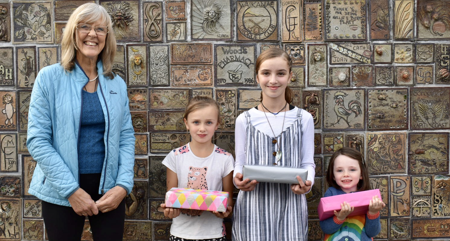 From the left: Sue Lusk, from Destination Waikanae; Lola Fifield (winner of the 5-10 year old category); Zahira Masters (winner of the 10-15 years category); Emmeline Vallance (winner from the under-fives category).