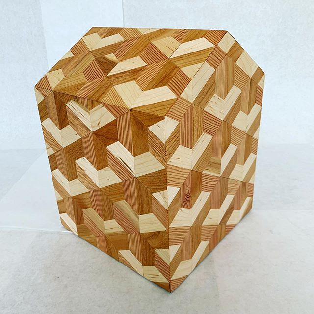 """Inspired by the art of MC ESCHER, this gable-shaped wood urn combines Alder, Maple and Fir, creating the optical illusion of tiered steps. 10"""" x 10"""" x 14"""" Design by Greg Lundgren.  Woodworking by Arne Pihl. #lundgrenmonuments  #modernurn"""