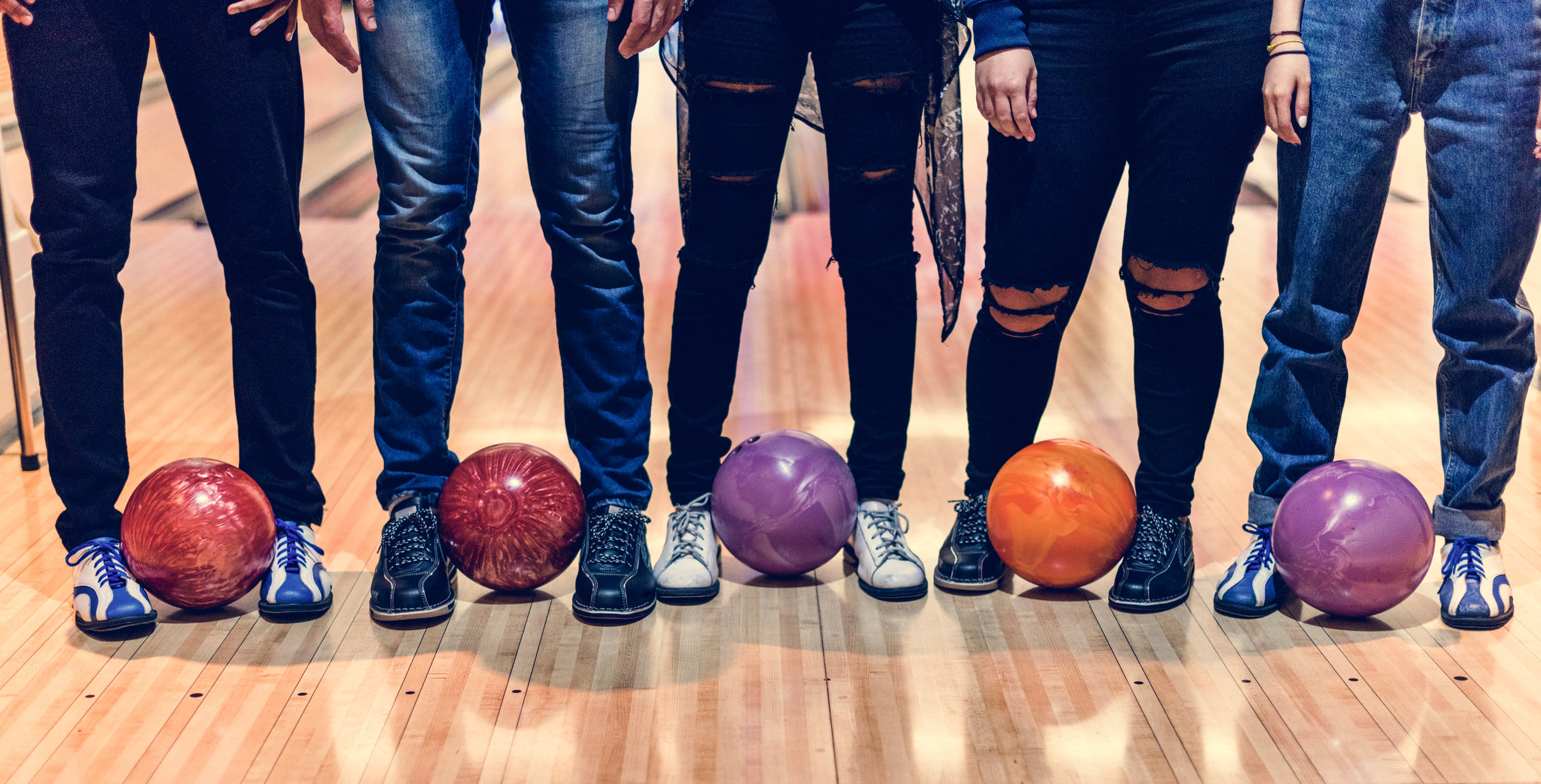 bigstock-Time-with-friends-at-a-bowling-243925540.jpg