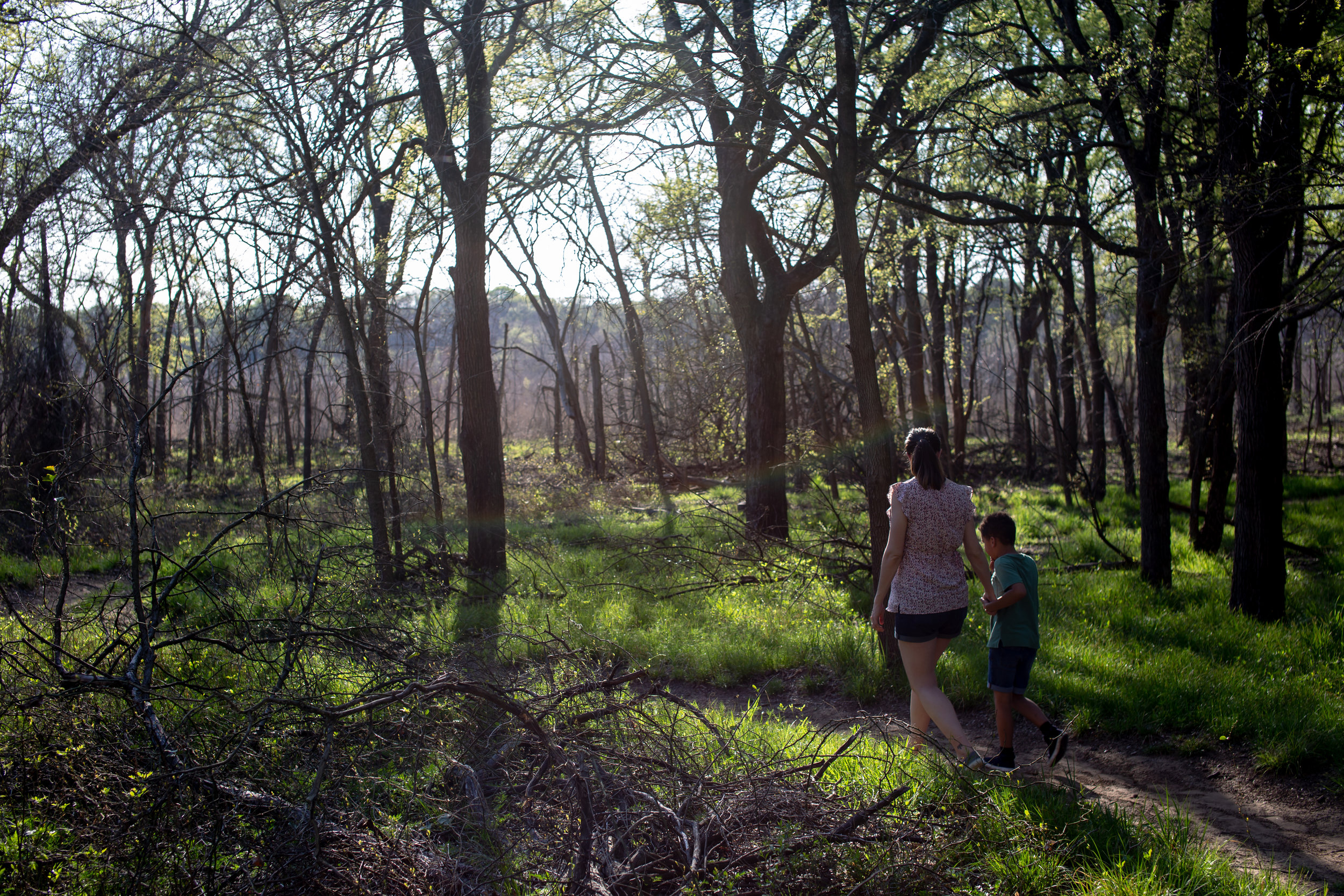 MARCH 26, 2019 | TWO HIKERS WALK THROUGH A TEXAS TRAIL DURING THE FIRST DAYS OF SPRING.