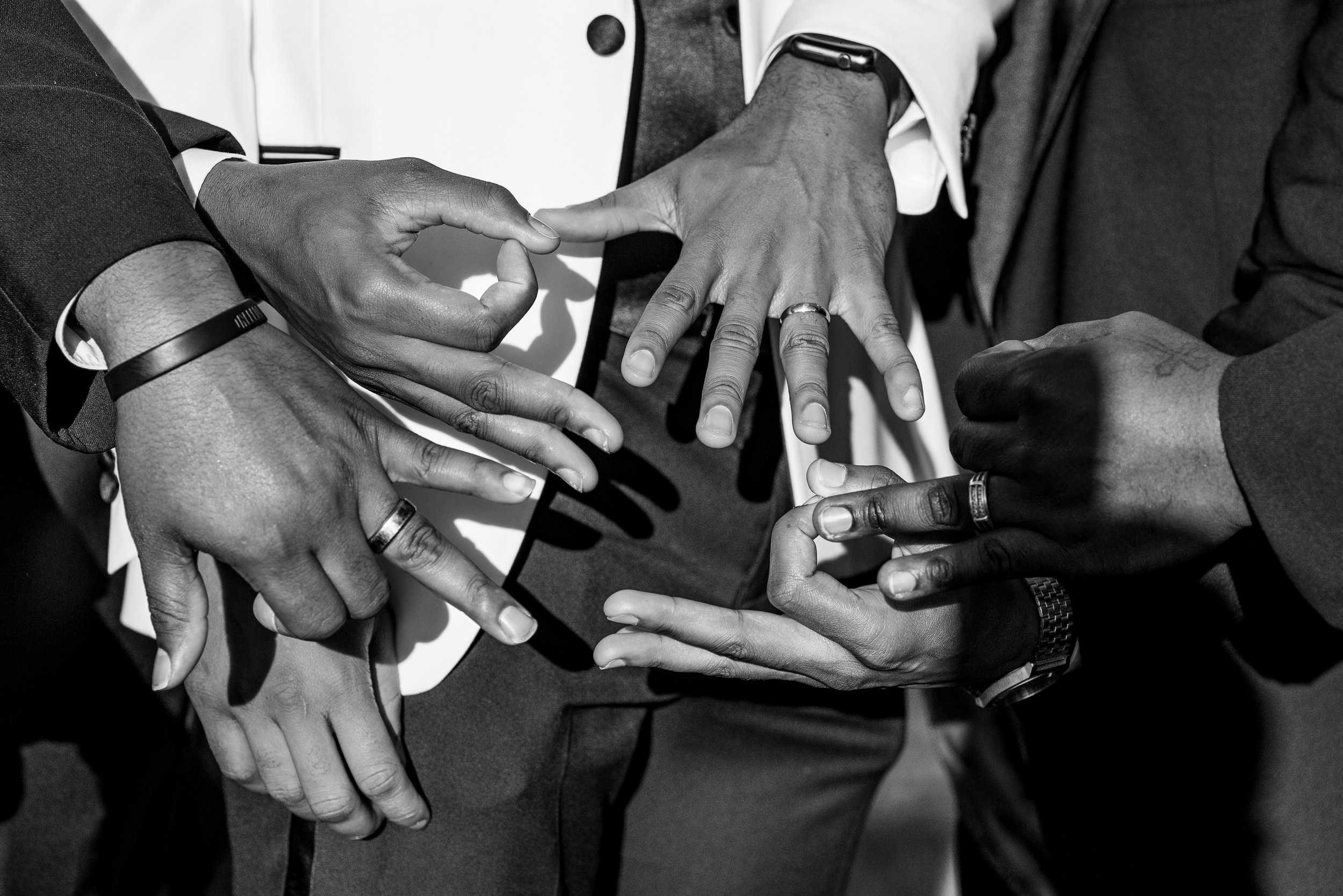 APRIL 20, 2019 | A GROOM AND HIS GROOMSMEN THROW UP SIGNS FOR THEIR HOOD.