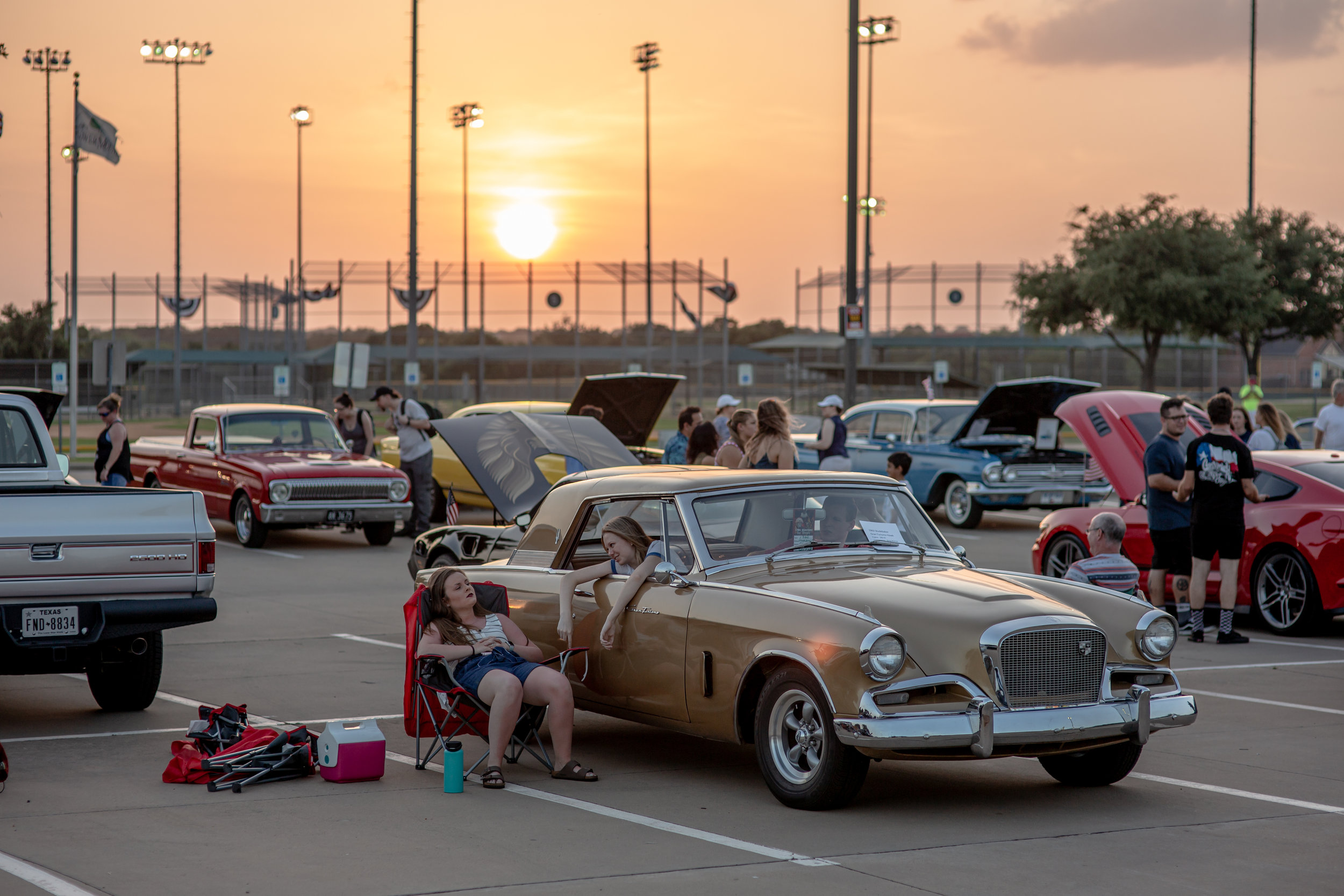 JULY 4, 2019 - TWO YOUNG GIRLS HANGOUT AND TALK DURING A CAR SHOW AT THE ANNUAL INDEPENDENCE DAY FESTIVAL OF FLOWER MOUND, TEXAS.