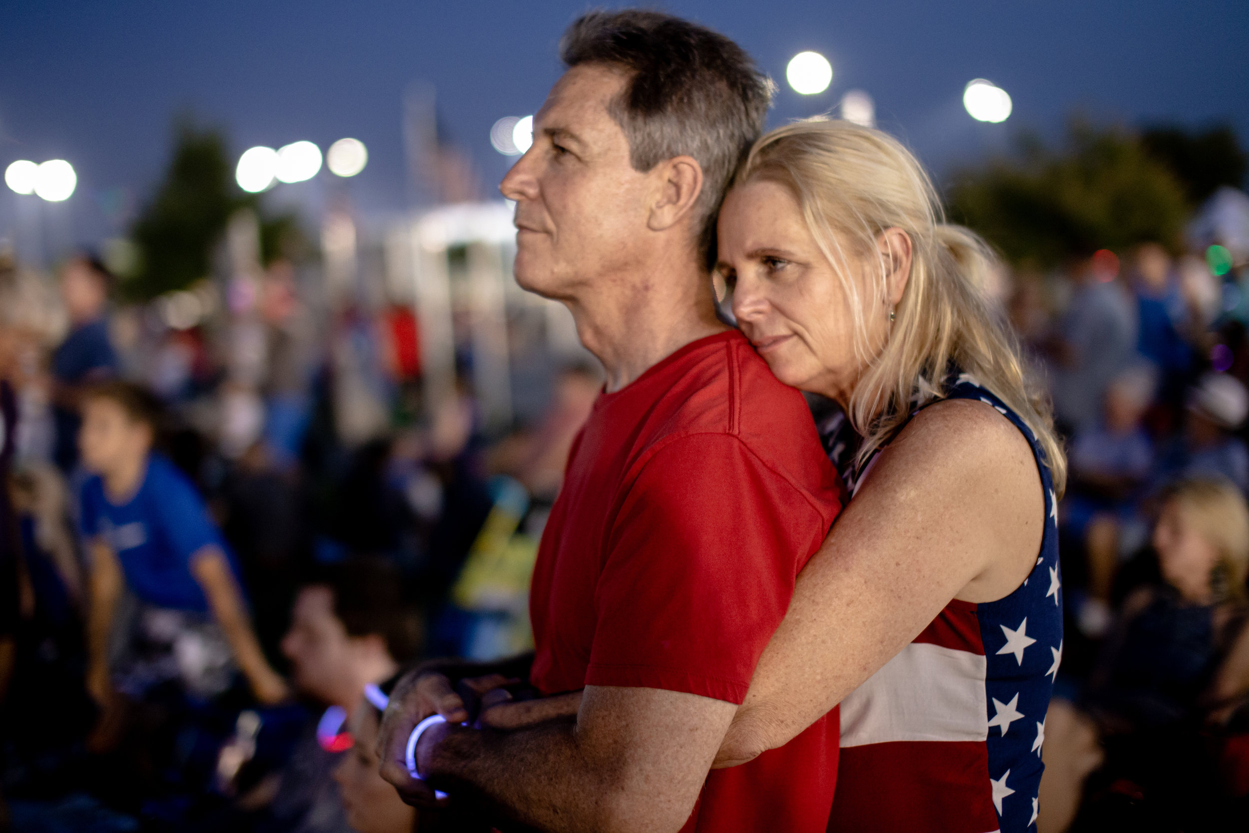 JULY 4, 2019 - A COUPLE WATCHES THE STAGE AT THE ANNUAL INDEPENDENCE DAY FESTIVAL OF FLOWER MOUND, TEXAS; AS BRET MICHAELS SINGS SWEET HOME ALABAMA.