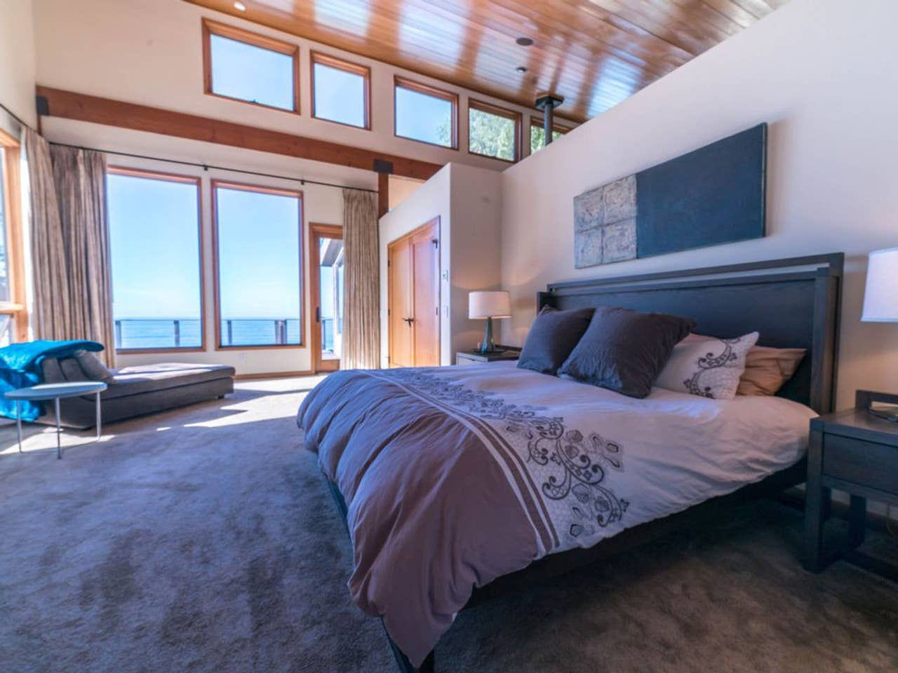 Shared King Bed + Twin Suite features huge windows and ocean views.