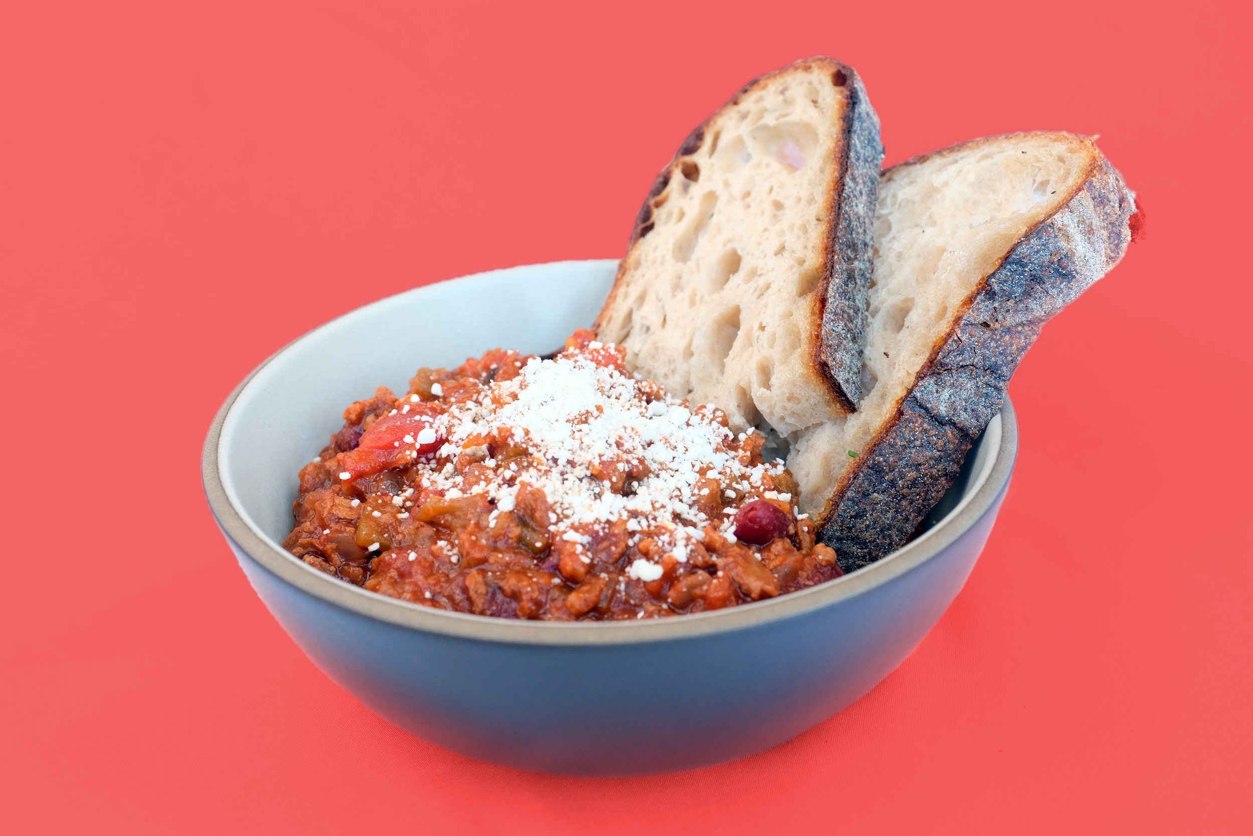 Unicorn Meat Chili - The flavors of this chili are inspired by the desert southwest and the sauces help boost the umami flavors. Using enamel cast iron helps caramelize the red tomatoes into a deep brown sauce.
