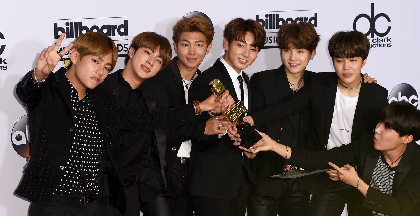 BTS shows off their brand new Billboard Music Award after the show.
