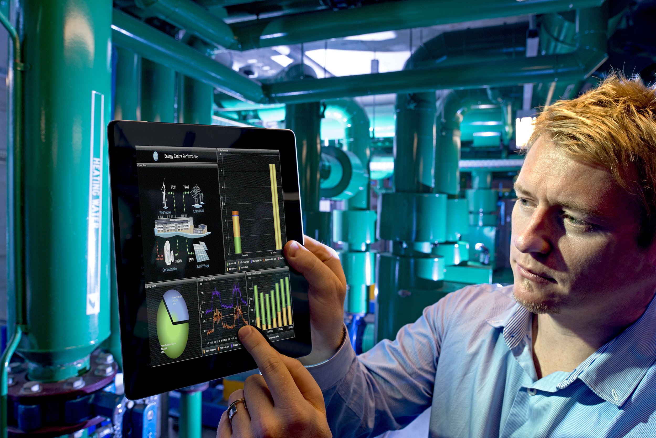 CSIRO_ScienceImage_2041_A_man_looking_at_a_tablet_in_an_energy_facility.jpg