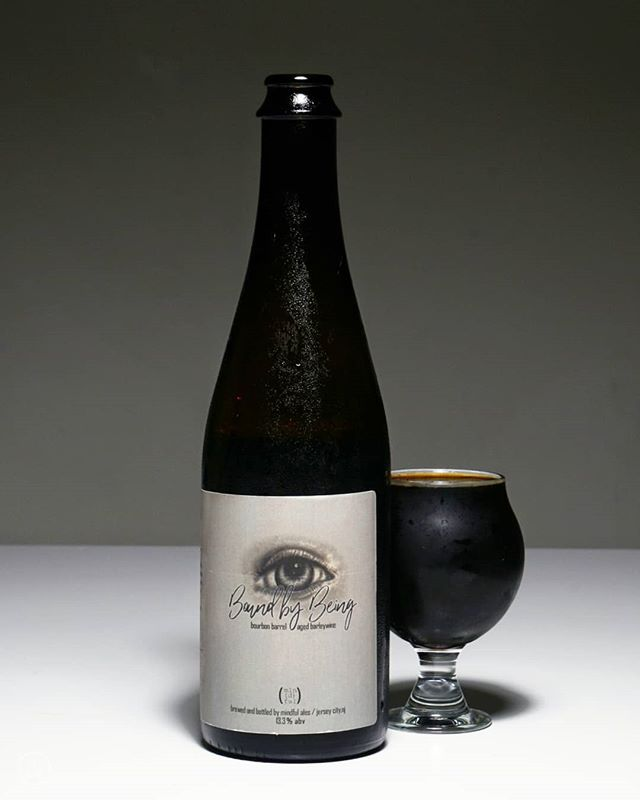 """Today I'm throwing back to this beauty of a bourbon barrel-aged barleywine called Bound by Being (yes, I did try to use all the words starting with """"b"""" that I could). BbB is a beer by @mindfulales that was brewed with @nycbeersociety and released earlier this year. Rich and heavy, this barleywine leaned into the toffee/caramel flavors, giving the whole thing a brown sugar note. There was a nice mix of tobacco and plum as well and a nice barrel character. Jason was on a recent episode of Hop Talk, about the Back to Basics series of homebrews. Be sure to check it out!"""