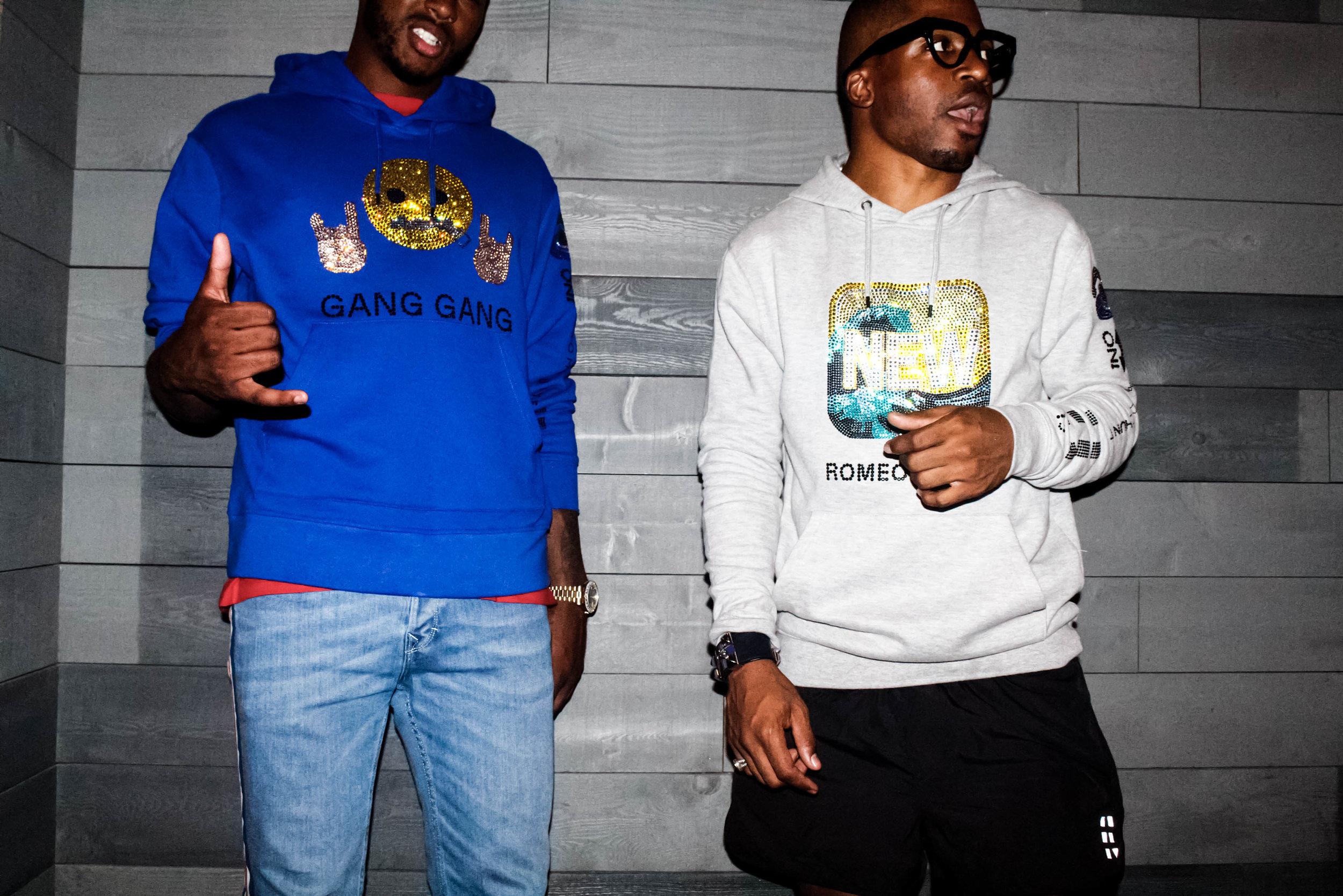 Trevor Jackson and Romeo Hunte wearing hoodies designed by Romeo Hunte, photographed by Founder Amanda Moore-Karim