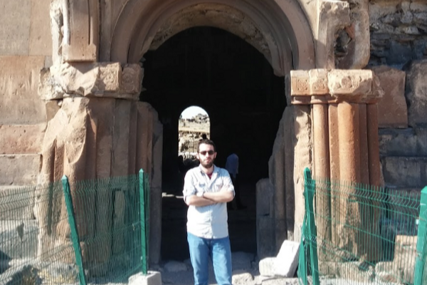 Ömer stands in front of the Ani ruins. Ani is an antique site that is located on Turkey and Armenia border. Once upon a time, the Silk Road was passing through in this town. It is also in the UNESCO World Heritage sites list.