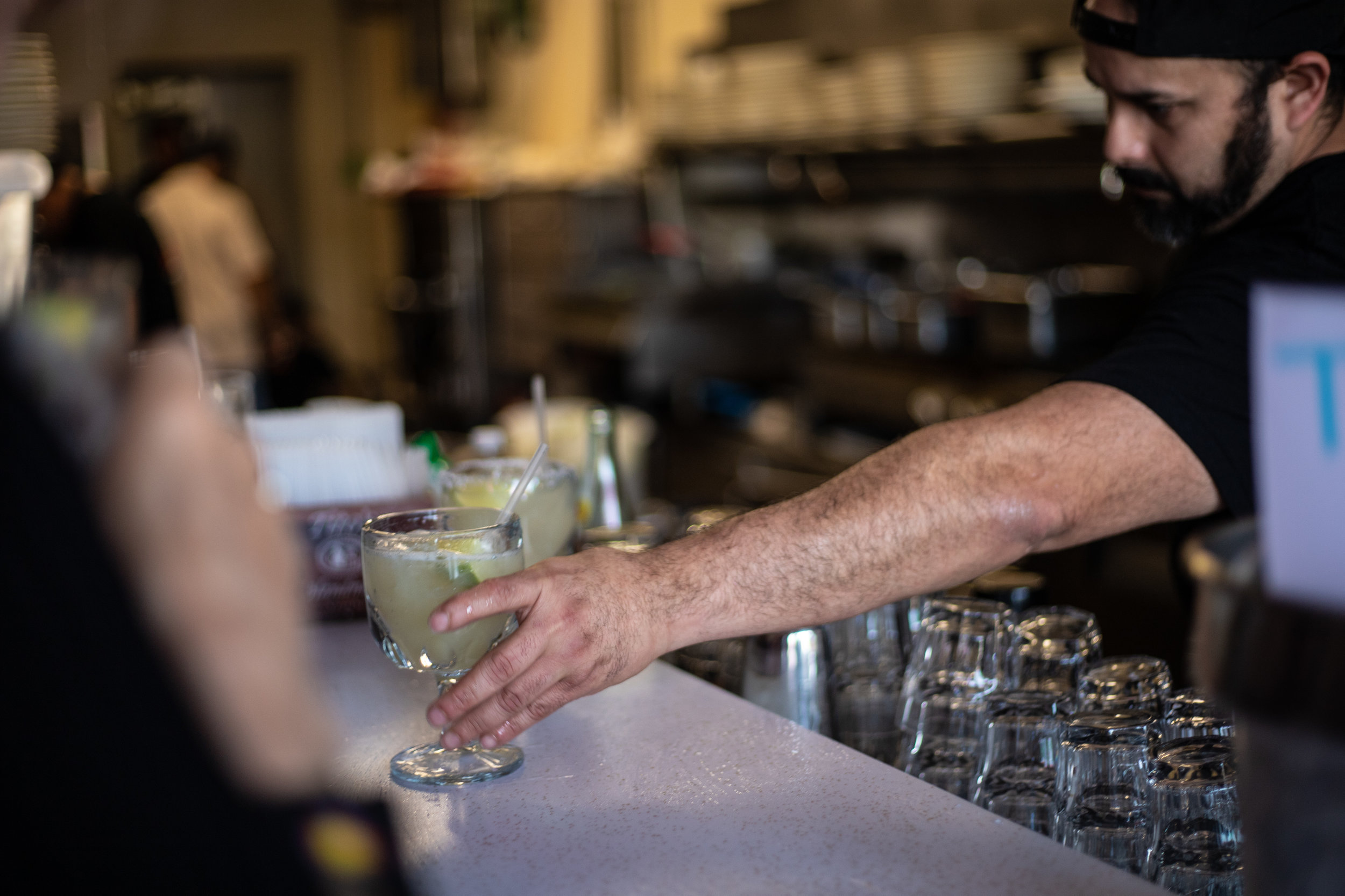 The bartender at Cisco's serving up rounds of margaritas for family and friends to get in the party spirit.