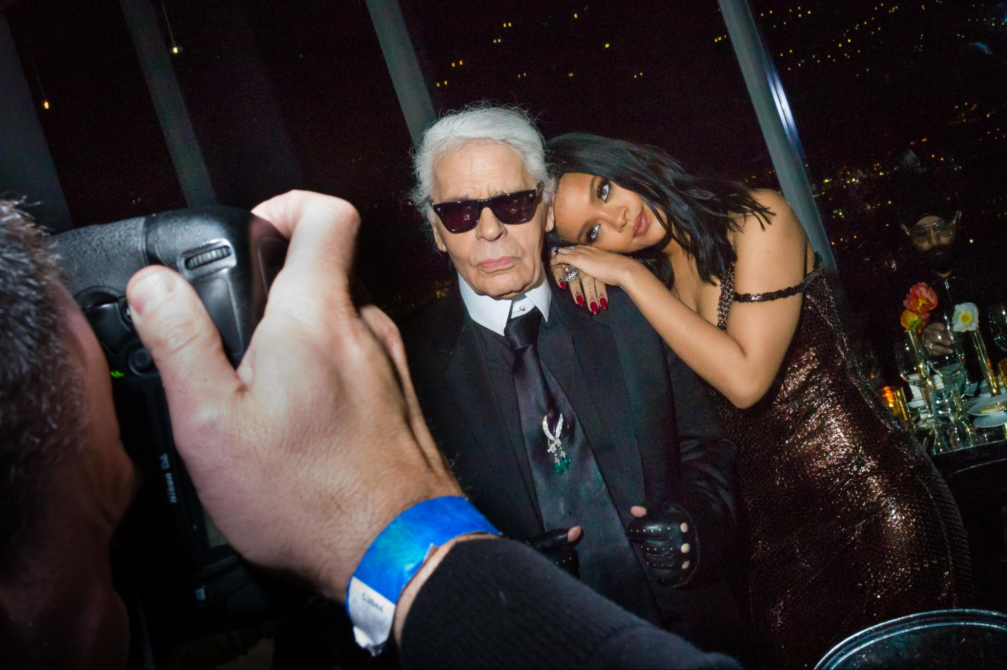 Mr. Lagerfeld with the singer Rihanna at a Fendi dinner in New York in 2015.   Photo from Danny Kim for The New York Times