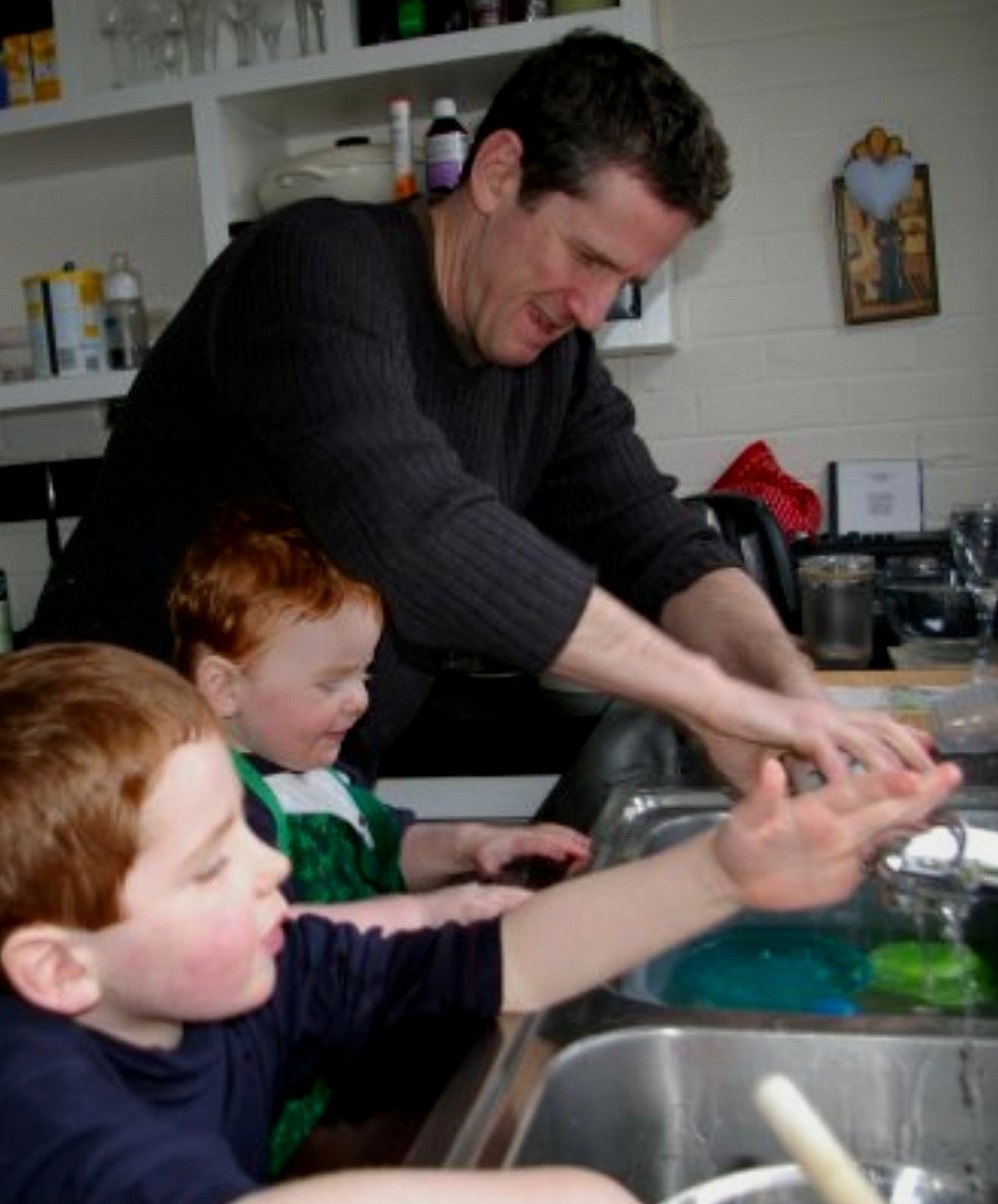 Parenting Magic - My boys with their dad busy in the kitchen having fun and making a beautiful mess! This was over 10 years ago so these guys are now my teenagers - 16 and 13 - a whole different ball game!