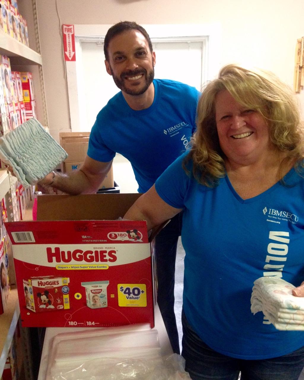 Volunteers sorting baby supplies.