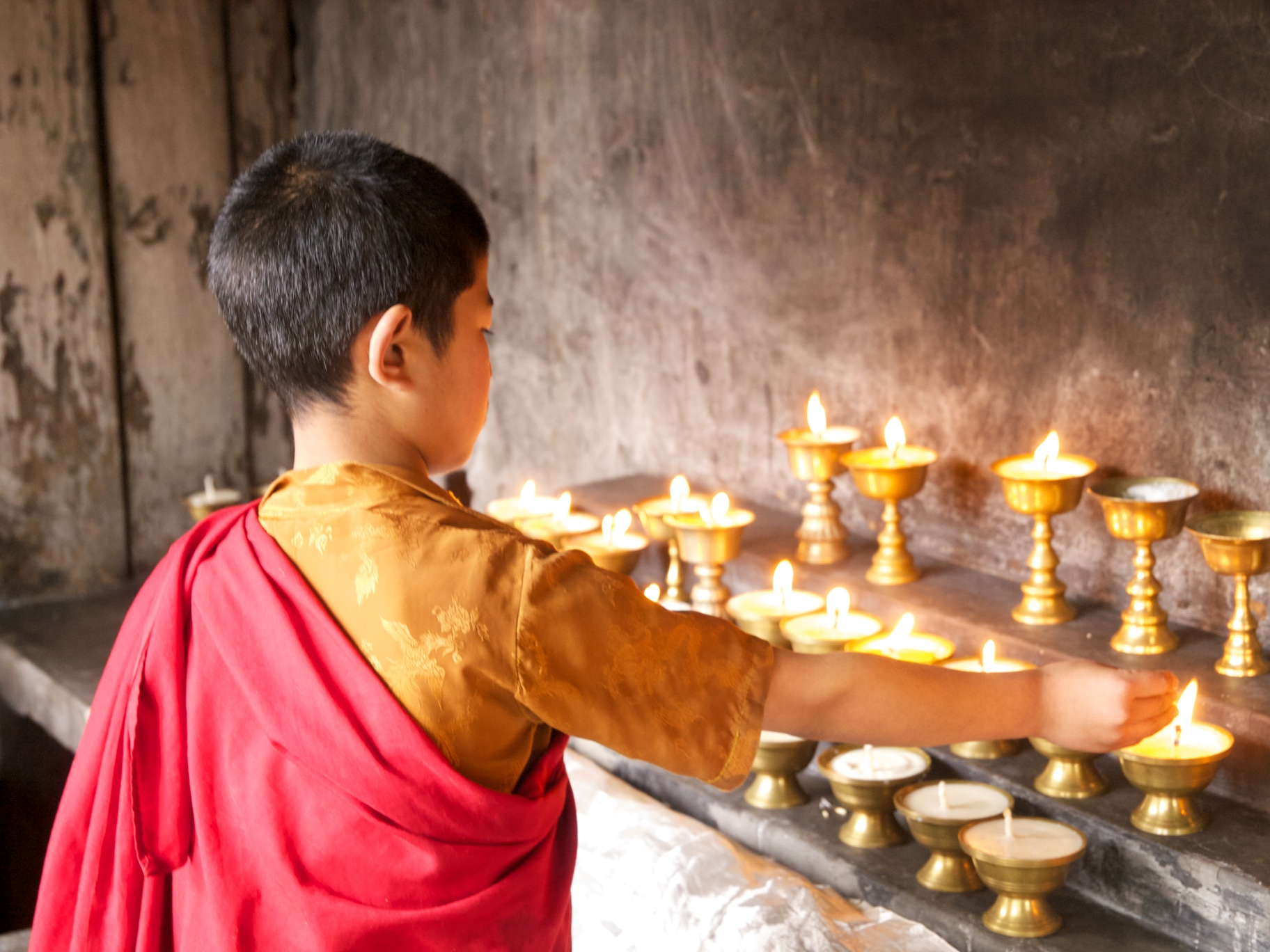 Lighting Butter Candles in Monastery