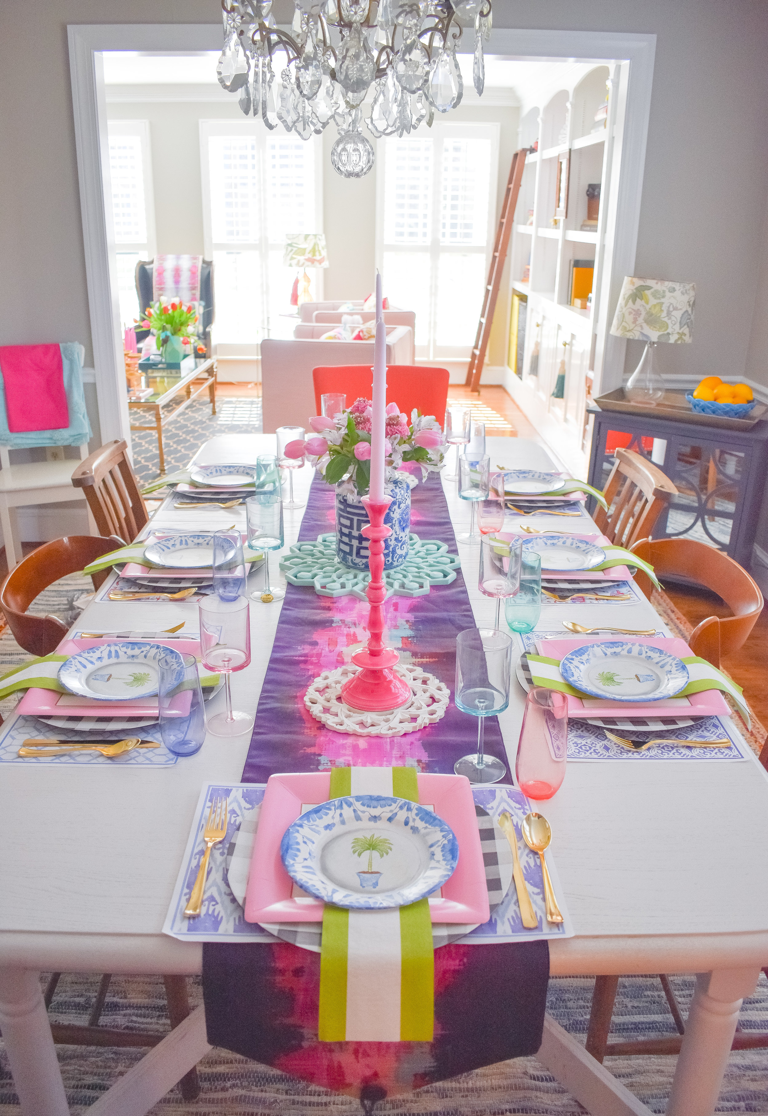 Plates and Napkins:  Caspari Line  Colorful Champagne Glasses:  Spritz for Target  Wine Glasses: Home Goods Candlesticks: Home Goods Table Runner:  Boho Luxe Home