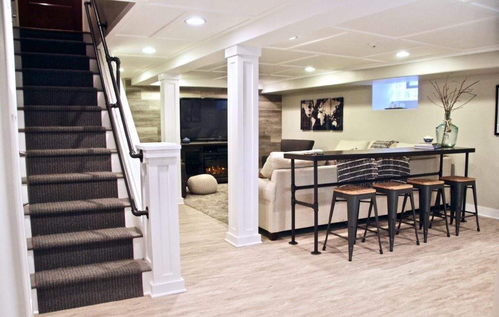 This amazing basement renovation from  Amie Freling- Brown of Meme Hill  is the very first picture Paul found for inspiration. I love how she added extra table seating behind the sofa. Genius! Paul loves the accent wall behind the tv.
