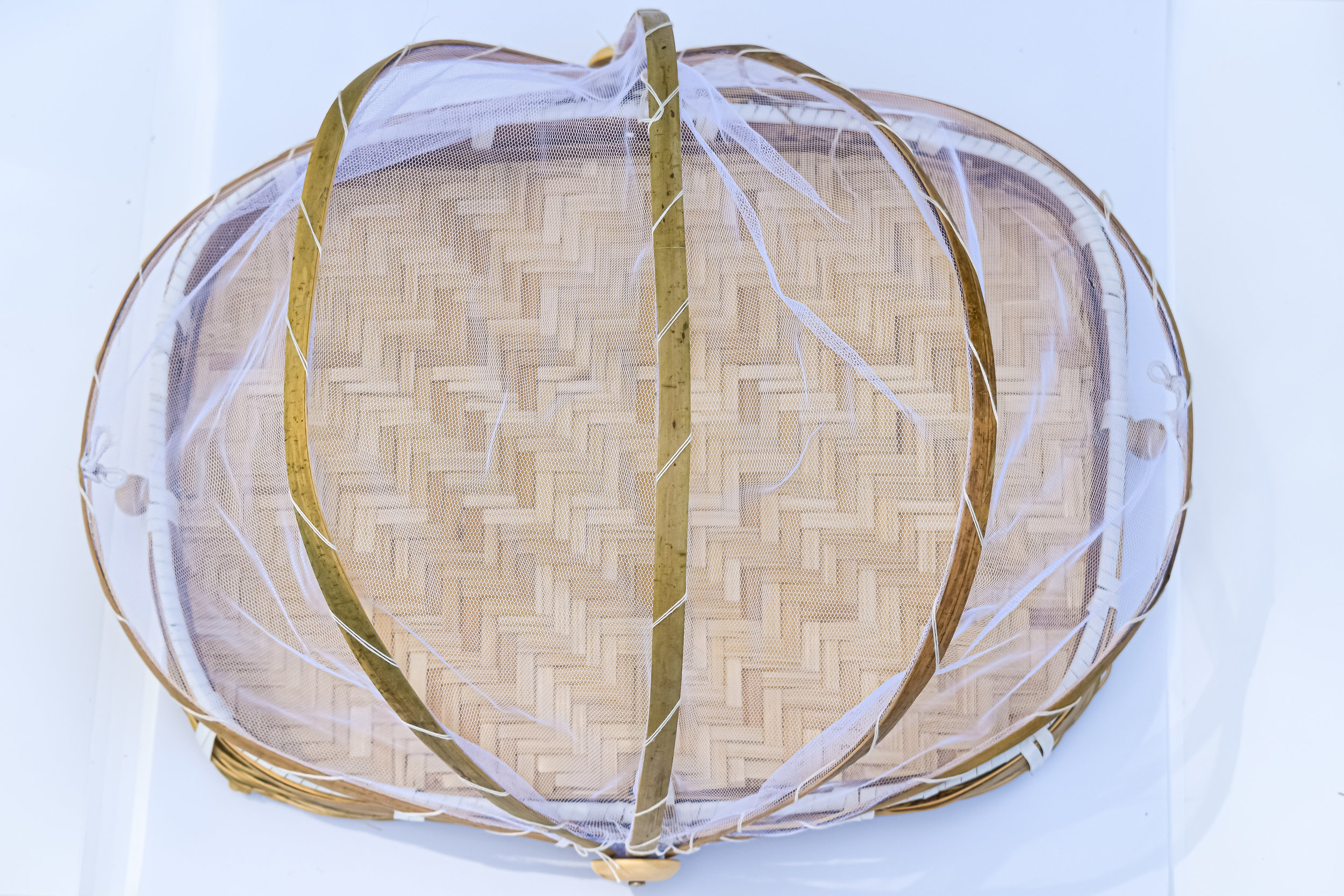 This covered wooden tray is perfect to reuse this summer when you're having all the wine and cheese but did not invite the bugs. Pull this cover over and you're all good!  Covered Tray:  Home Goods