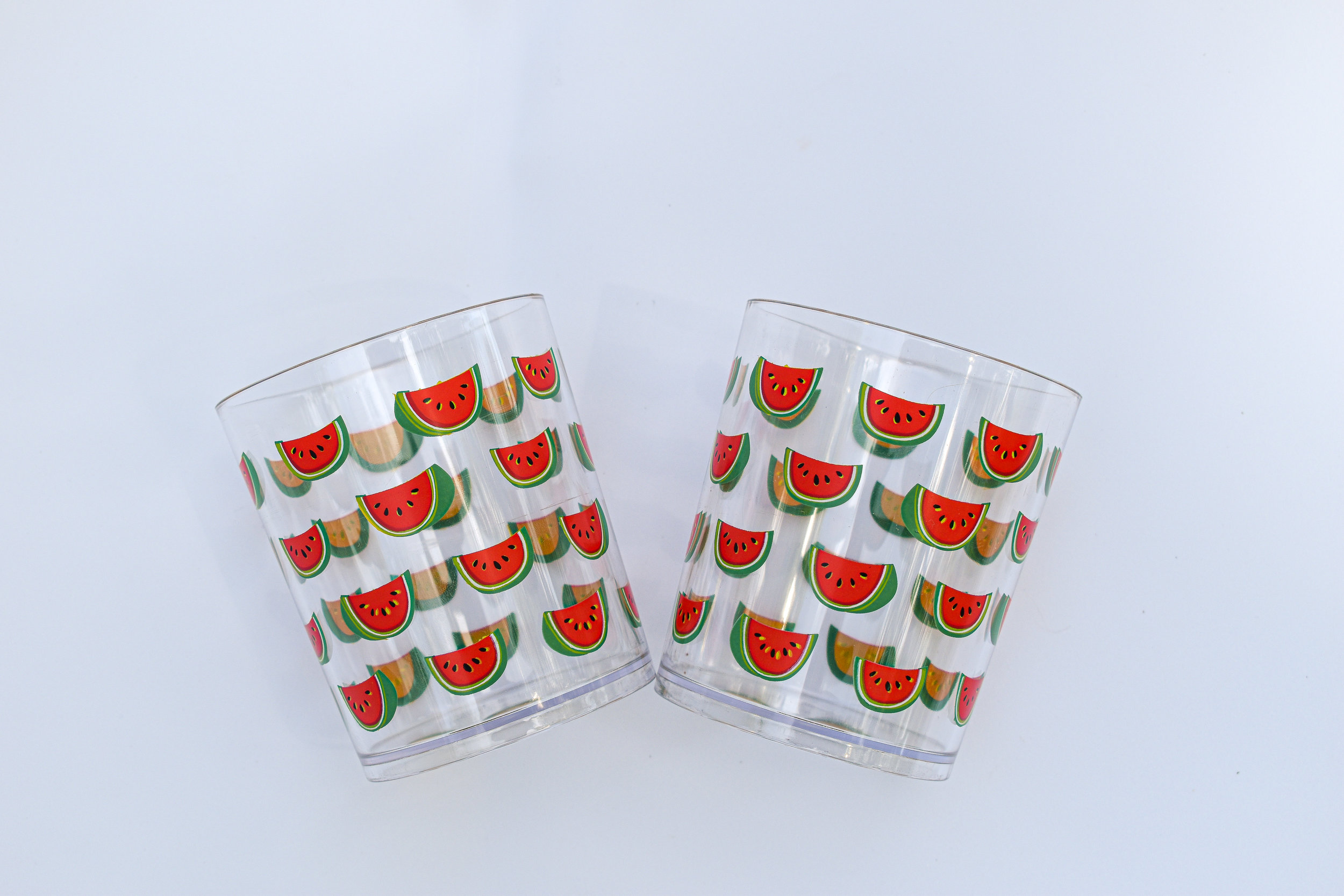 And who's gonna say no to plastic, dishwasher safe, cute watermelon art, cocktail glasses? Have all the drinks you want in these. If you, and they, fall in the pool, they won't break!