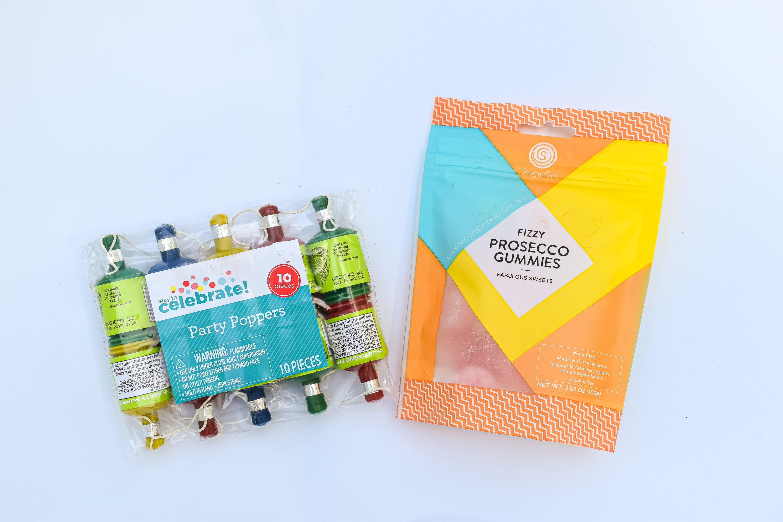 Why not add to the celebratory feeling by including prosecco gummies and confetti party poppers? You all, Ribbon and Twine Design basically had me as soon as they sent me a photo of the prosecco gummies. They know my weakness.