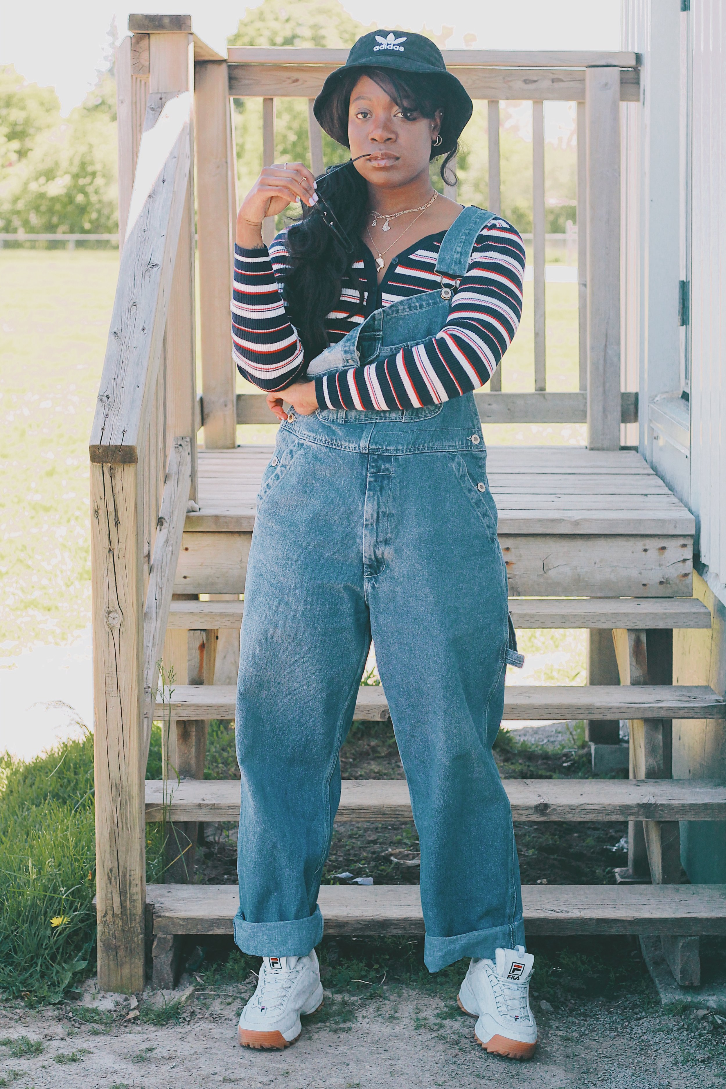Vintage overalls // winners button-up cardigan // File Disruptor II's // Adidas bucket hat -