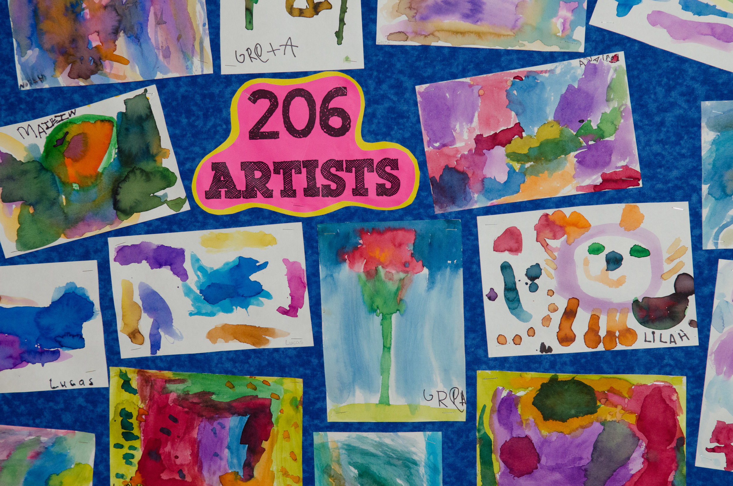 Art is integrated into all of our classes - though some of our favorite portraits come from our K-1 students!