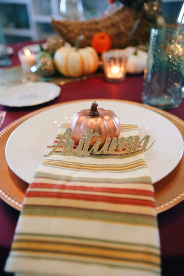 Striped Napkin with Sparkly Name Cut Outs and Pumpkin Decor.JPG