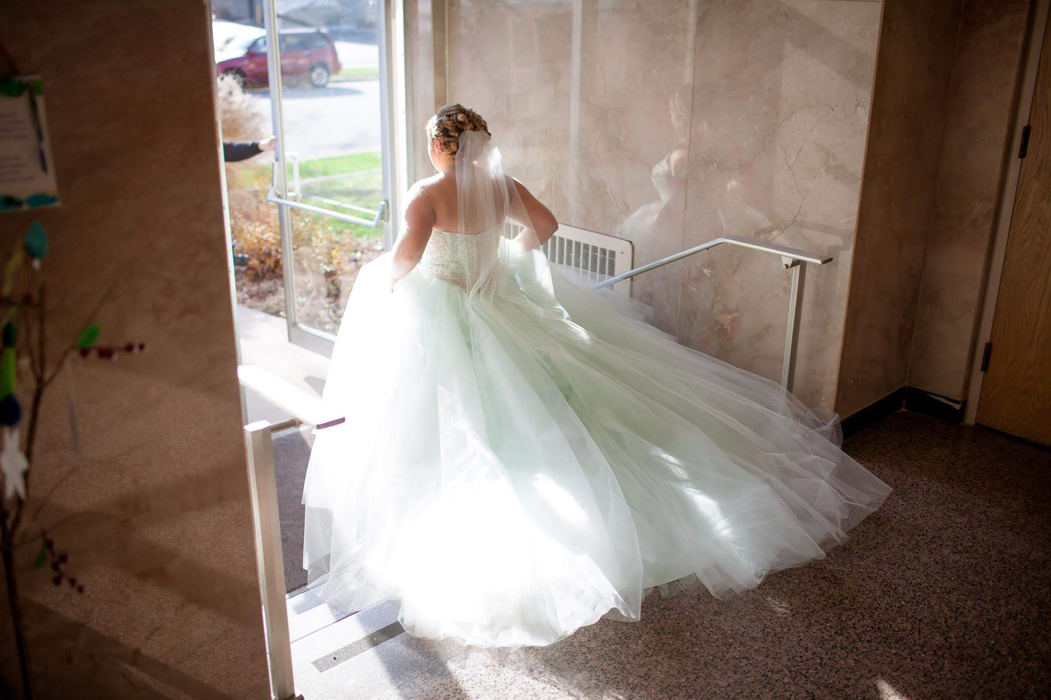 Photo by Leigh Photography    (Look closely! This bride's gown is a beautiful mint green hue.)