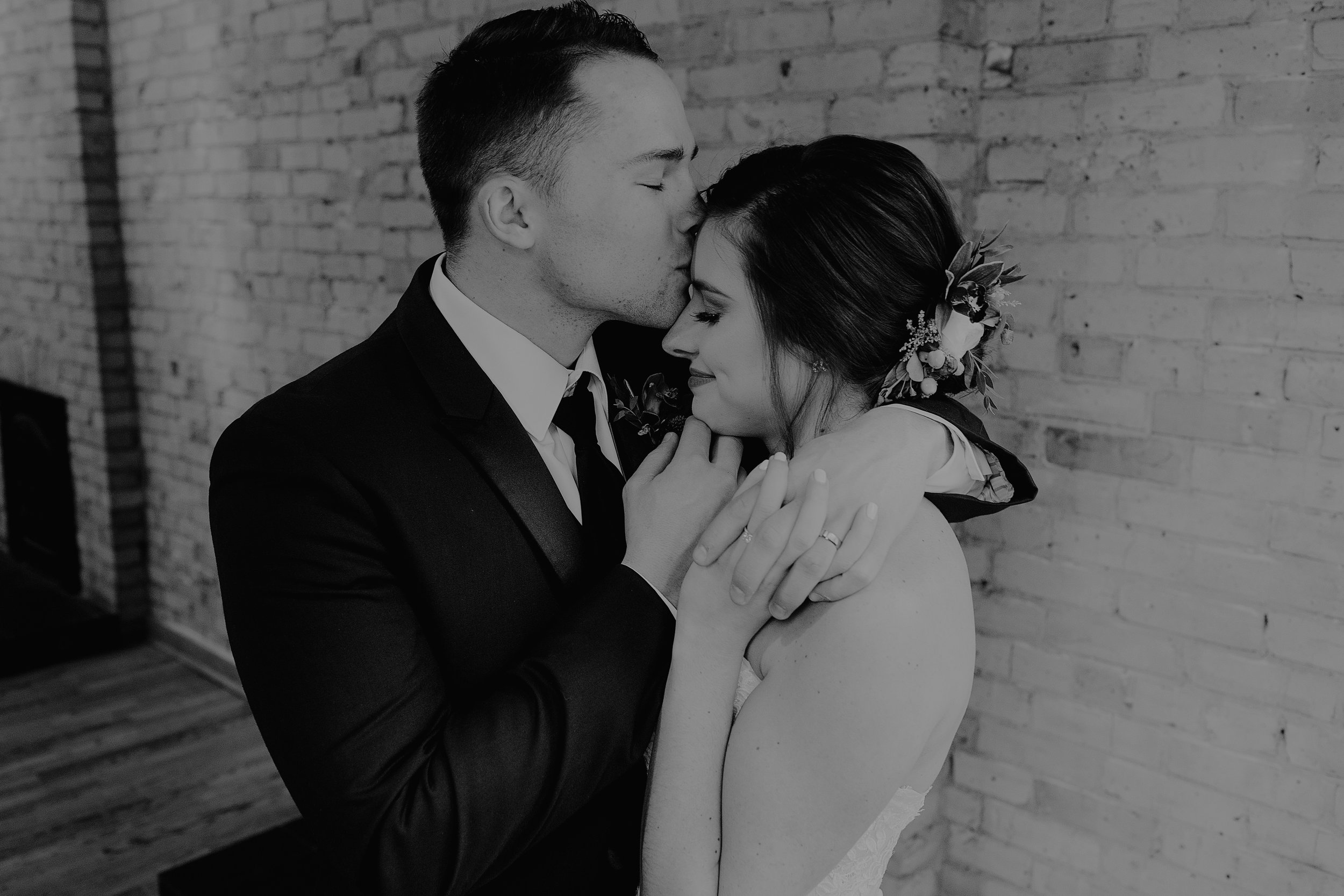 Groom Kissing Bride on Forehead - Wedding at Onesto in Milwaukee, Wisconsin