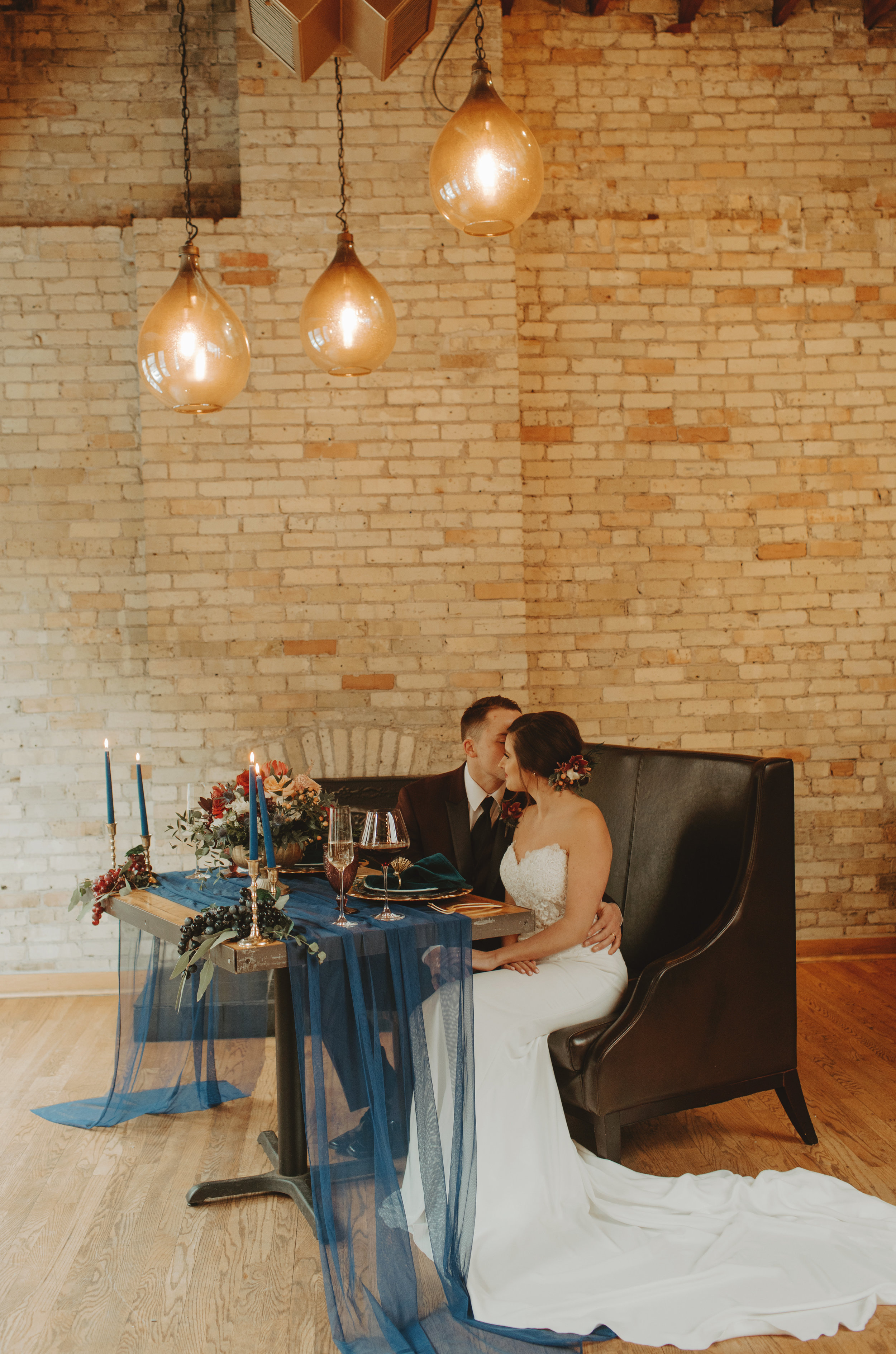 Emma and Buster Elopement - Bride and Groom at Sweetheart Table - by Nikki Kate Photography.jpg