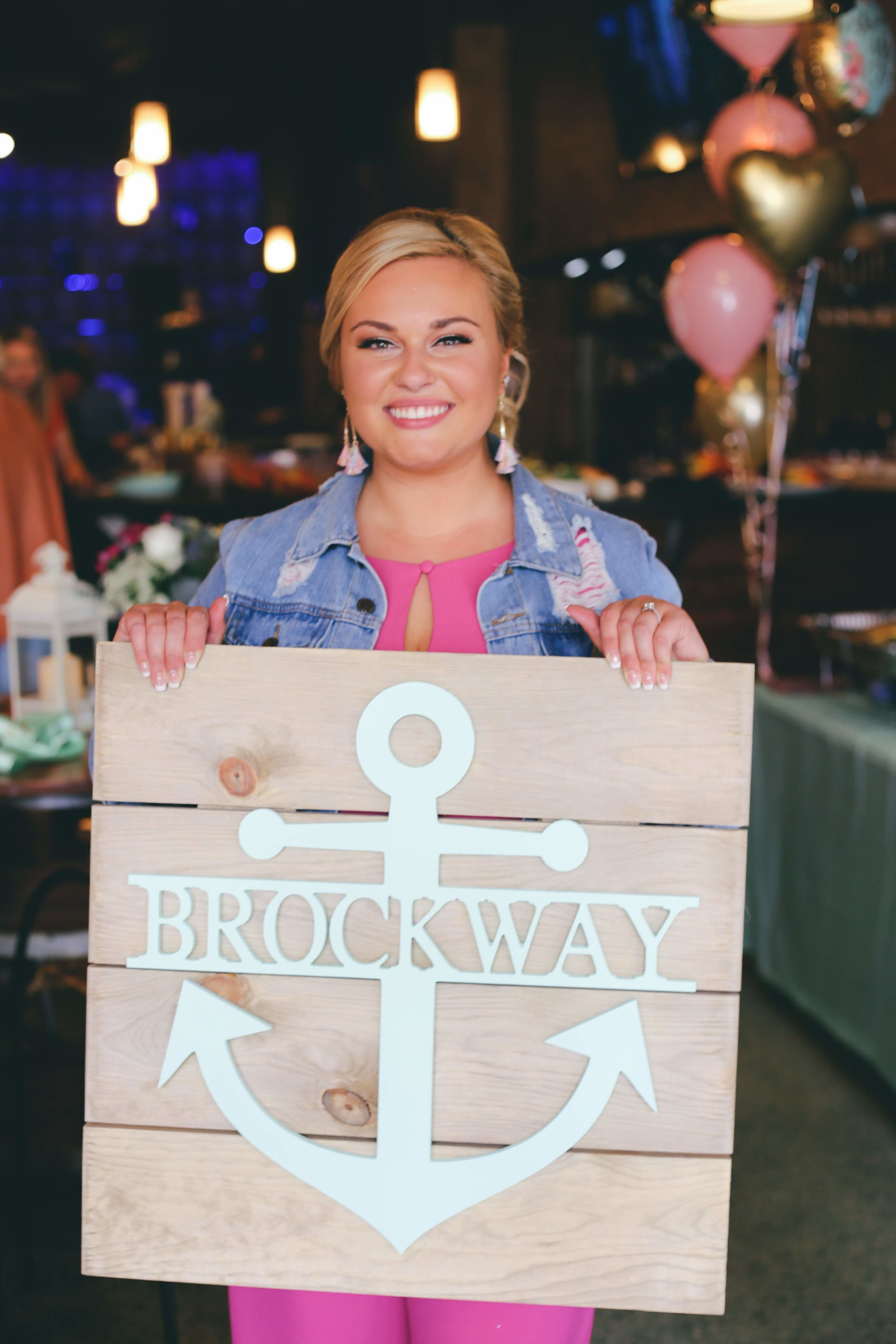 Nautical Bridal Shower at Vino Etcetera in Oconomowoc Wisconsin - The Bride with Brockway Anchor Sign - Photo by Danielle Kuenzi Photography
