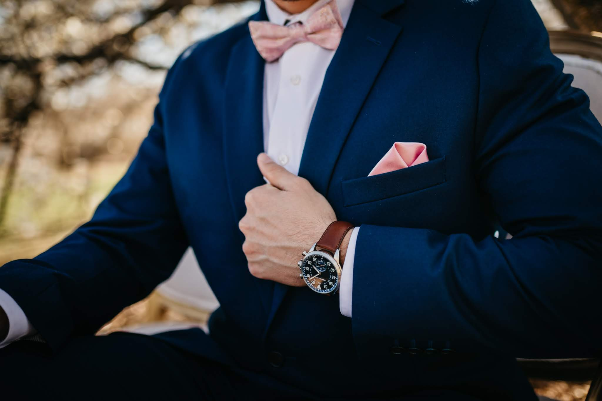 Groom in a Navy Blue Suit with a Blush Bow Tie - Spring Wedding at the UW Madison Arboretum in Madison Wisconsin - Phoenix & Rose Photography