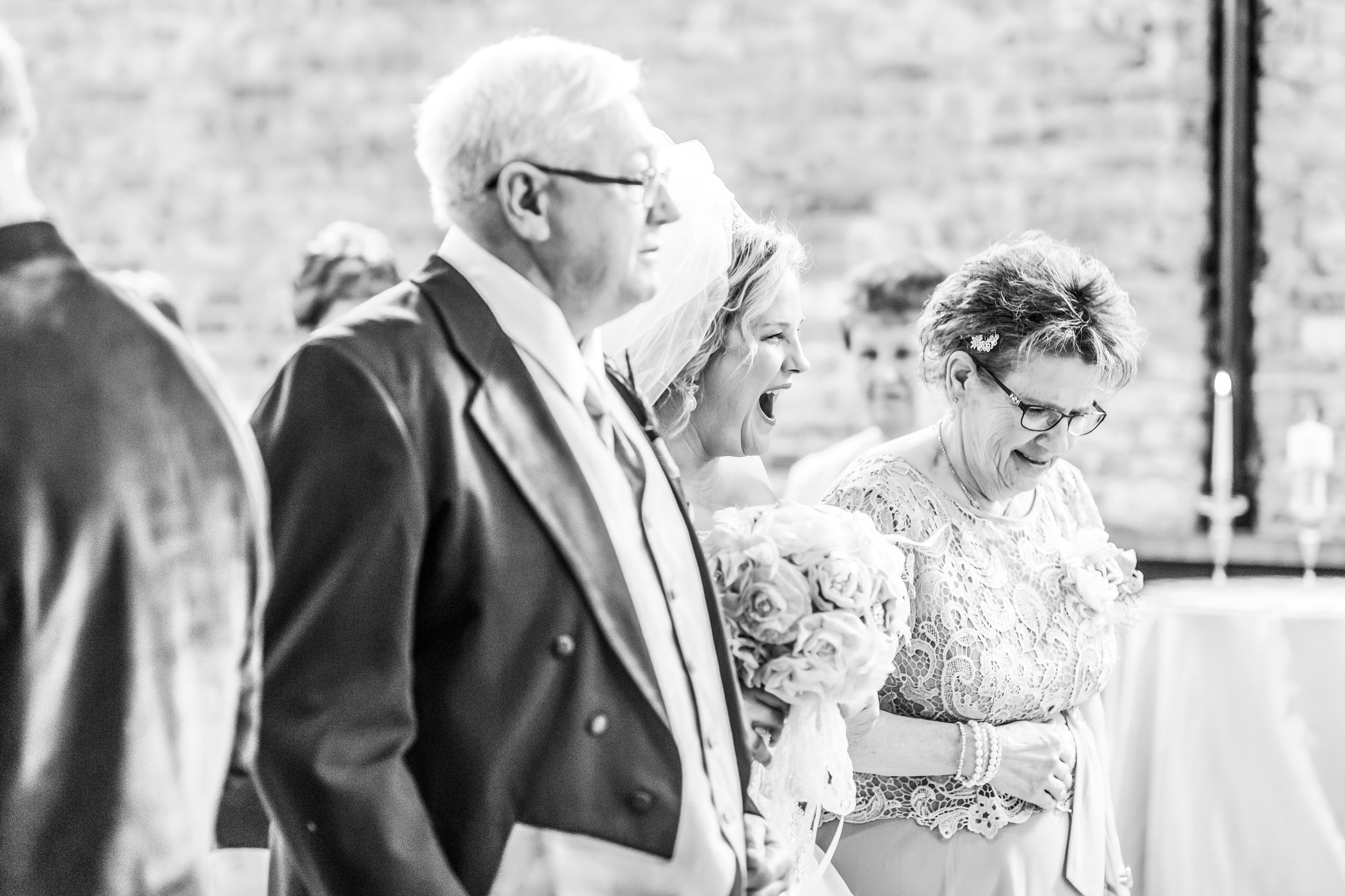Brides adorable reaction to seeing her groom at their wedding ceremony at Mercantile Hall