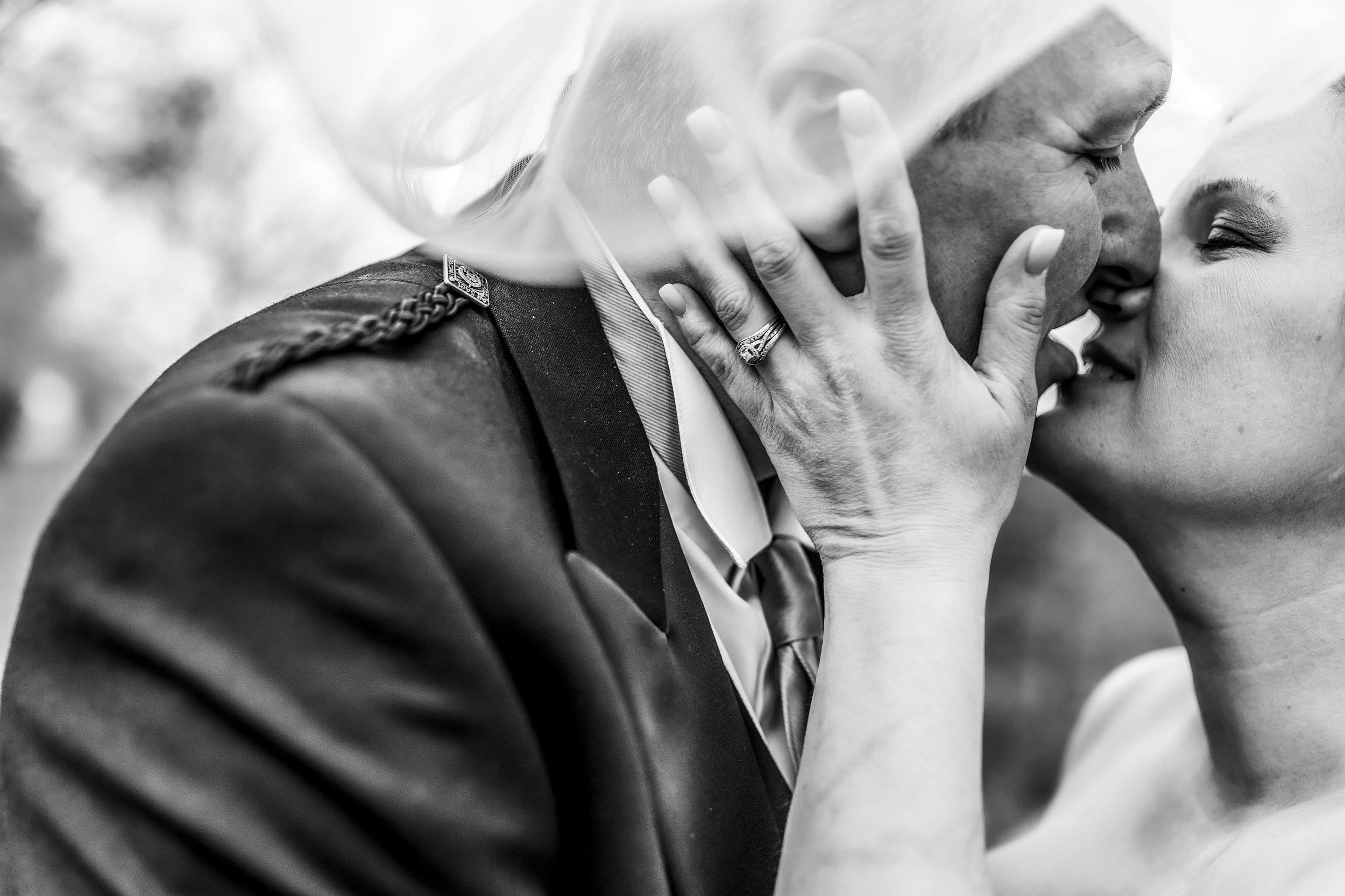 Bride and groom kissing under her veil - spring wedding in Wisconsin