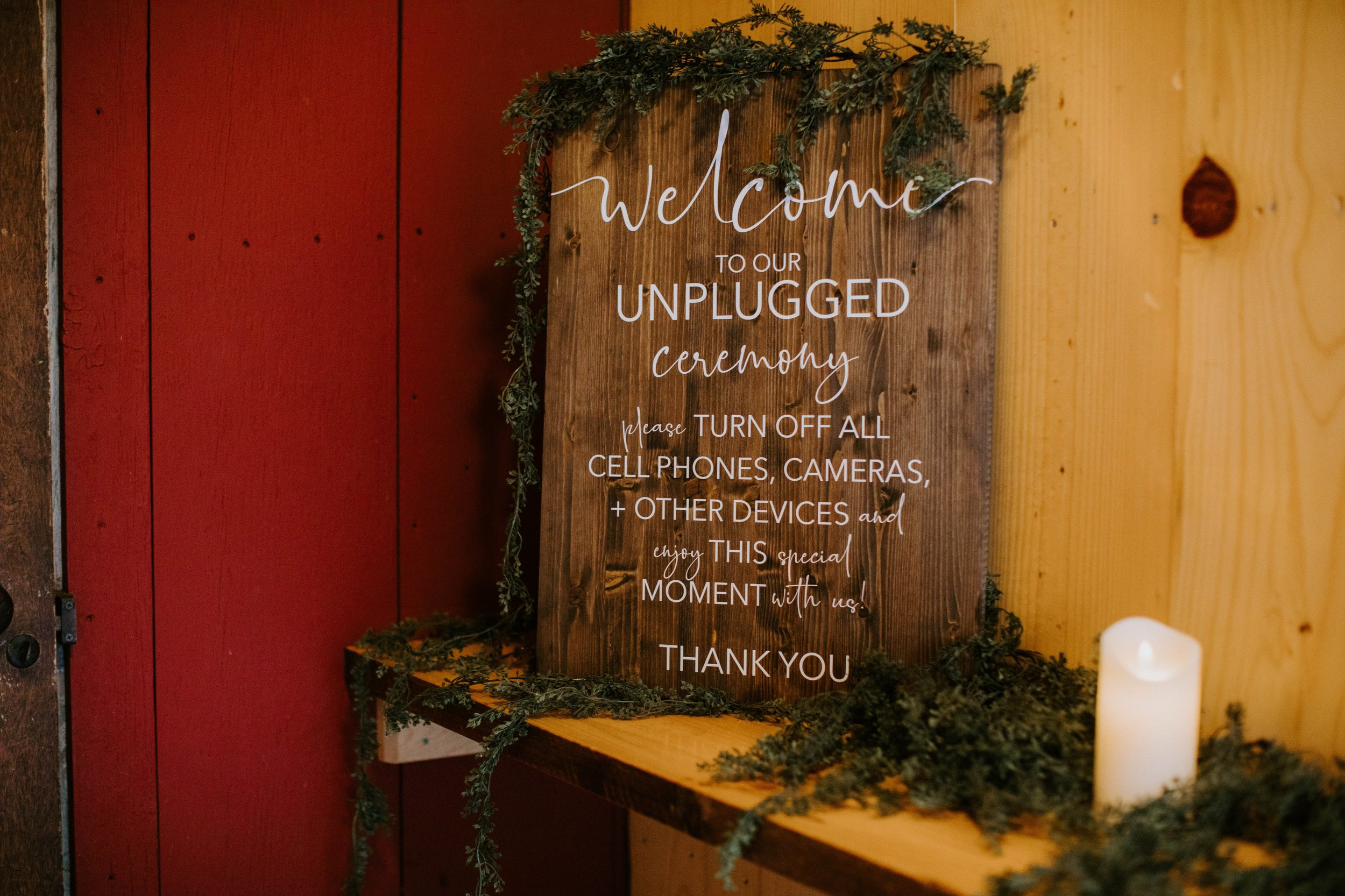 Unplugged wedding ceremony wood sign from a wedding at Lake Orchard Farm Retreat in Sheboygan, Wisconsin - Photo by Kaley Rae Photography.jpg