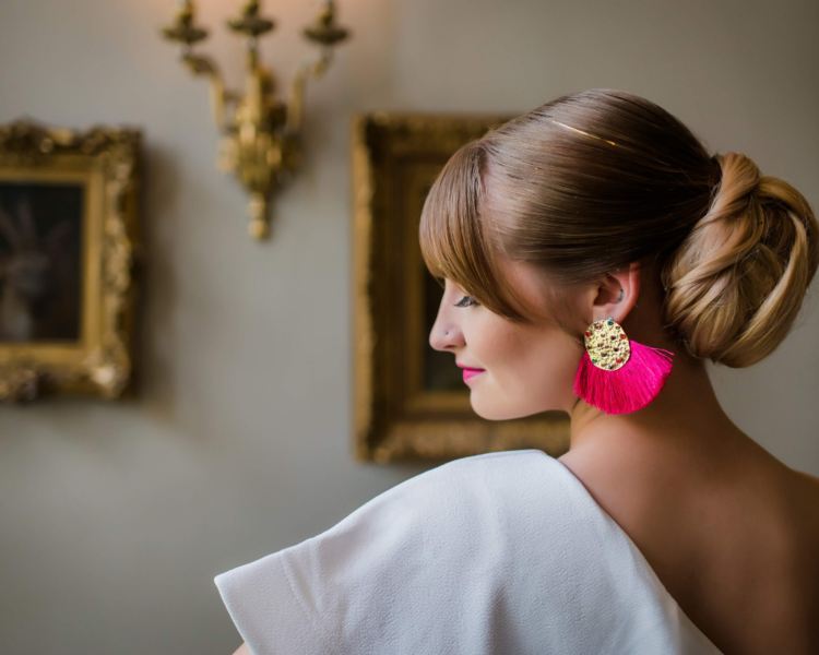 Bride with beautiful bright pink earings from a colorful artsy geometric wedding at Charles Allis Art Museum in Milwaukee Wisconsin - Photo by Reminisce Studio.png