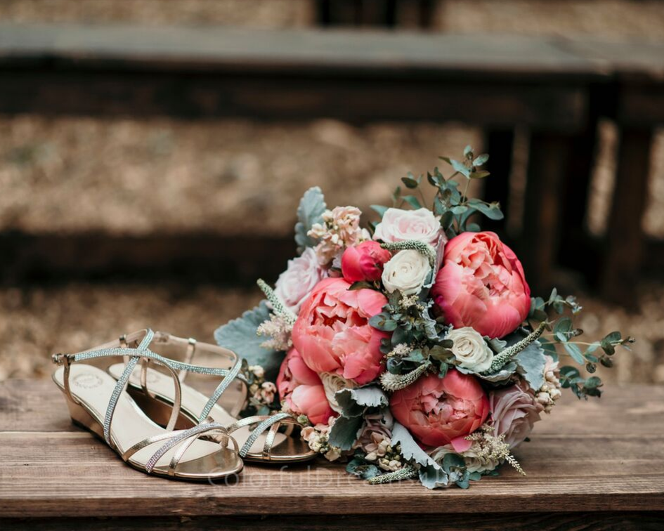 Wedding bridal bouquet and shoes photo - June backyard intimate summer wedding in Hubertus Wisconsin - Planned by Natural Elegance LLC - Photo by Colorful Dreams 4U.png